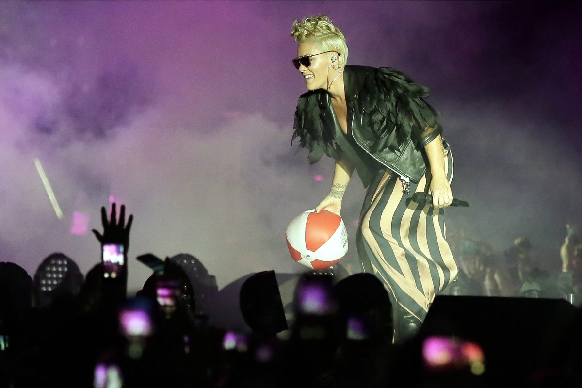 Pink tosses a beach ball back into the audience as her performance begins on the beach in Atlantic City, NJ on July 12, 2017.