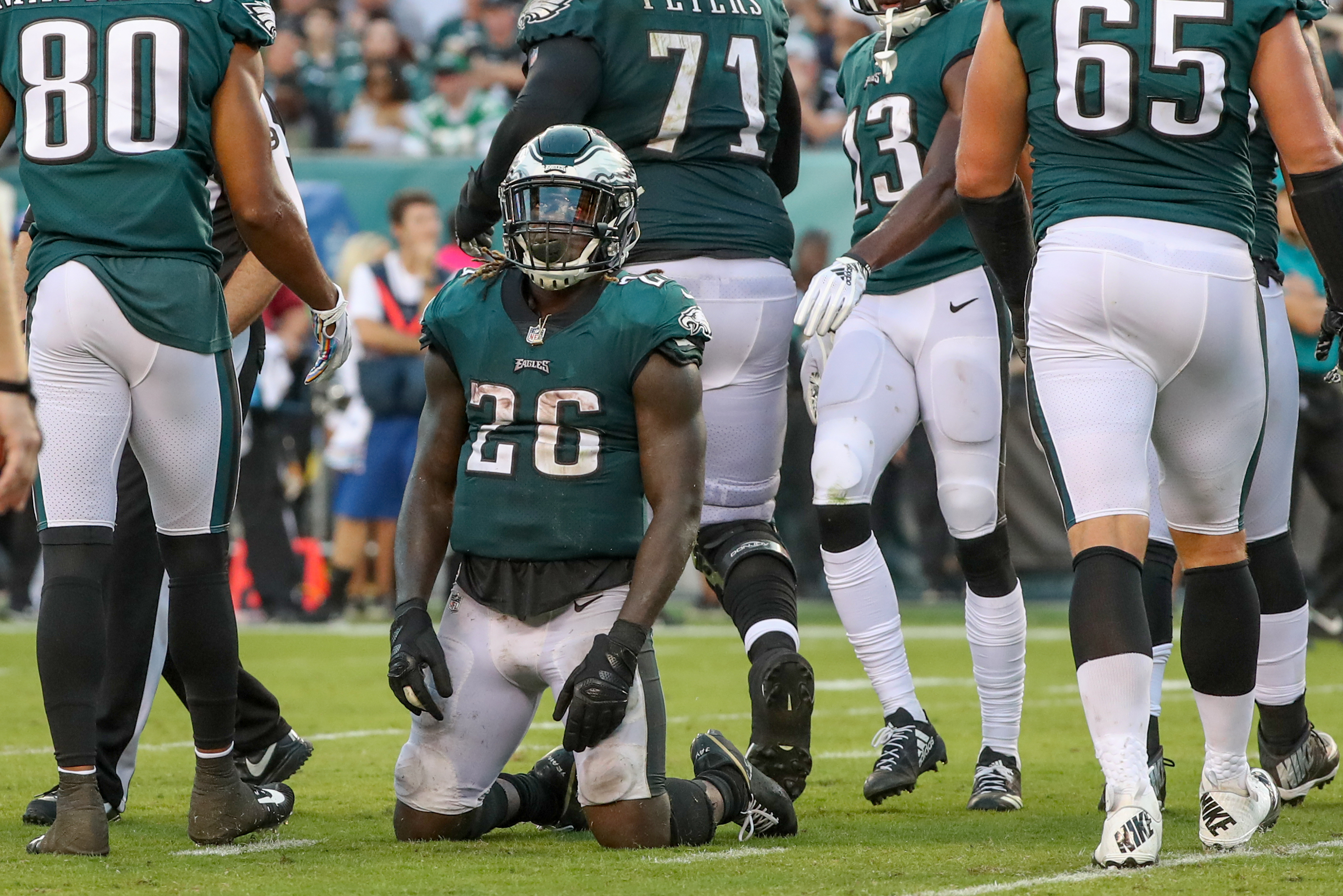 Jay Ajayi can only kneel on the ground and look to the sky after he fumbled the ball inside the 10-yard line as the Eagles were looking to score in the third quarter.