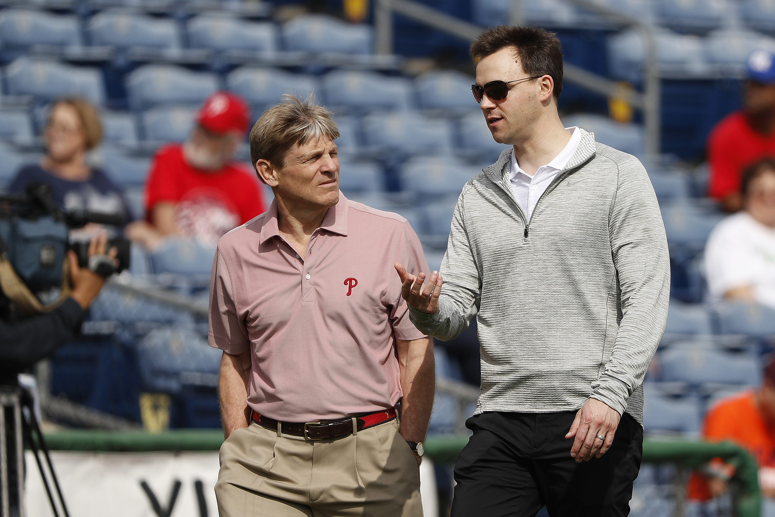 Phillies owner John Middleton, left, has money to spend this offseason. It will be up to general manager Matt Klentak, right, to determine how best to spend it.