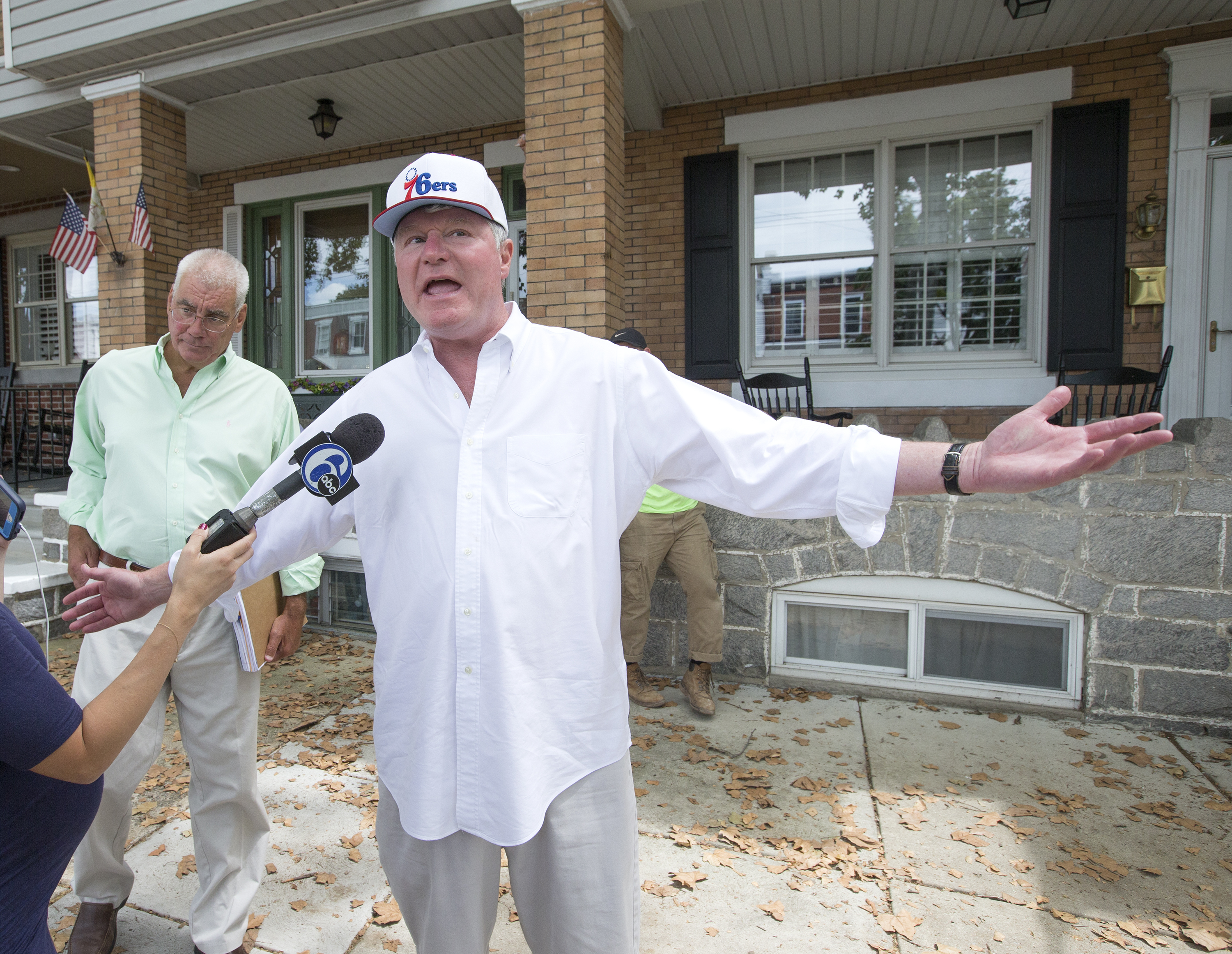 John Dougherty, right, makes some brief comments to the media on Moyamensing Ave. on Aug. 5, 2016. Law enforcement agencies were searching his home and his sisiter´s home as part of an investigation of the IBEW and it leader, John Dougherty.