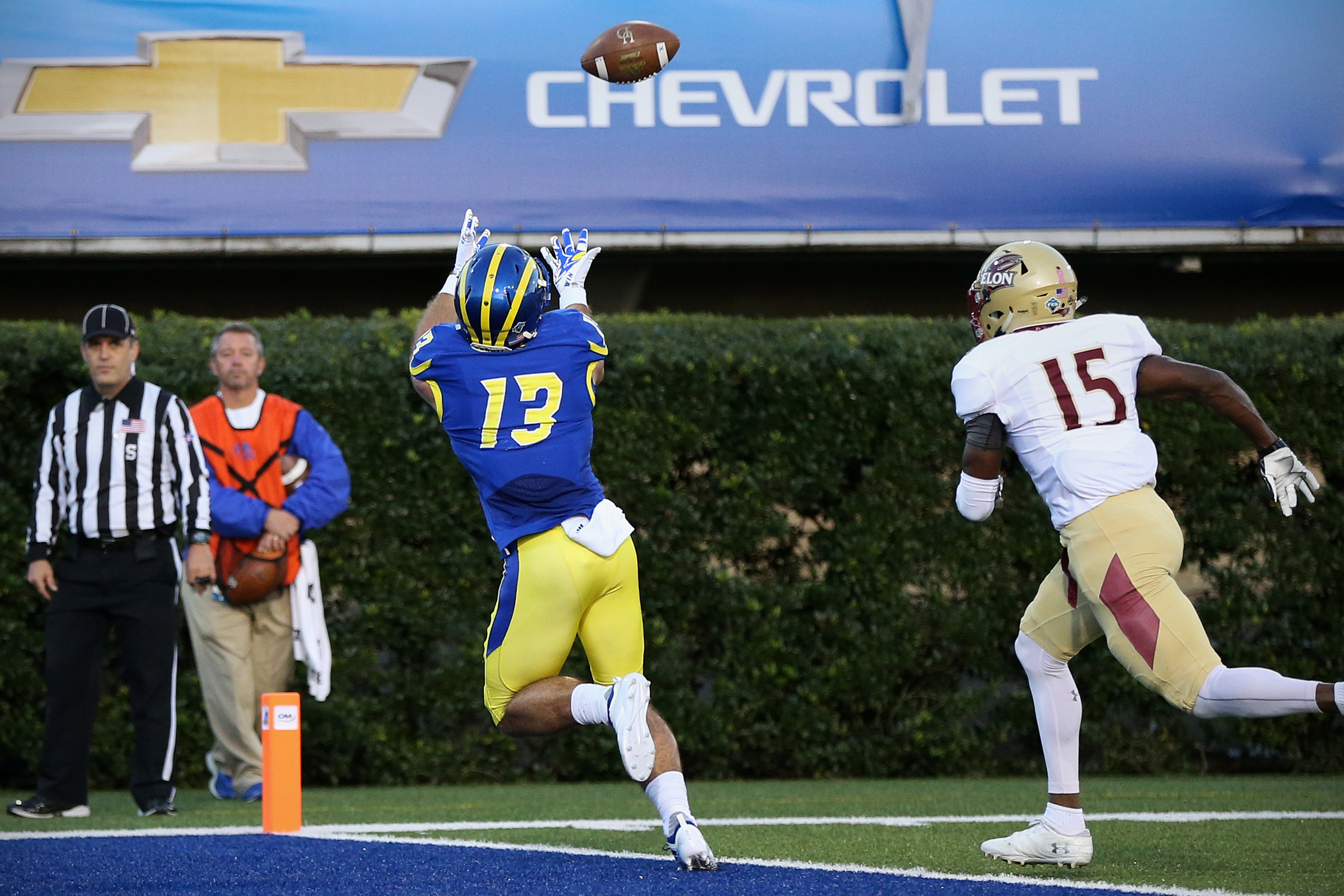 Delaware wide receiver Vinny Papale (13) catches a touchdown pass in front of Elon defensive back Jarquez Bizzell (15) during a game at Delaware Stadium in Newark, Del., on Saturday, Oct. 13, 2018. Delaware won 28-16. TIM TAI / Staff Photographer