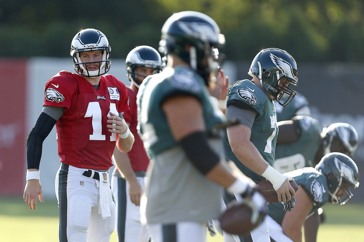 The Eagles' Carson Wentz waits for a drill to start during training camp last year.