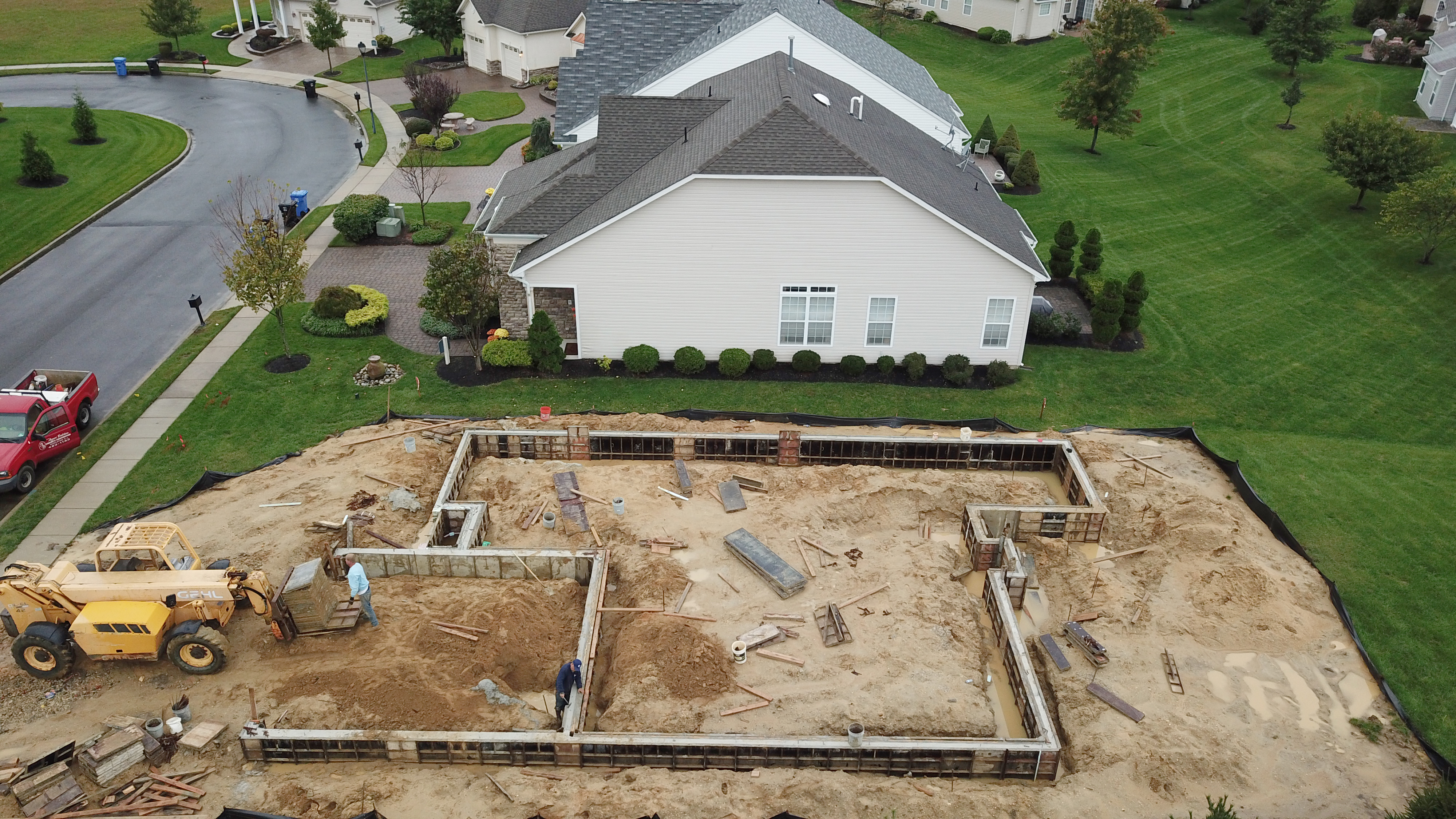 Workers prepare the foundation of a new home in Mantua Township, South Jersey, where builder Bruce Paparone is building an active adult community. Soon, they will use lumber to to frame the house.