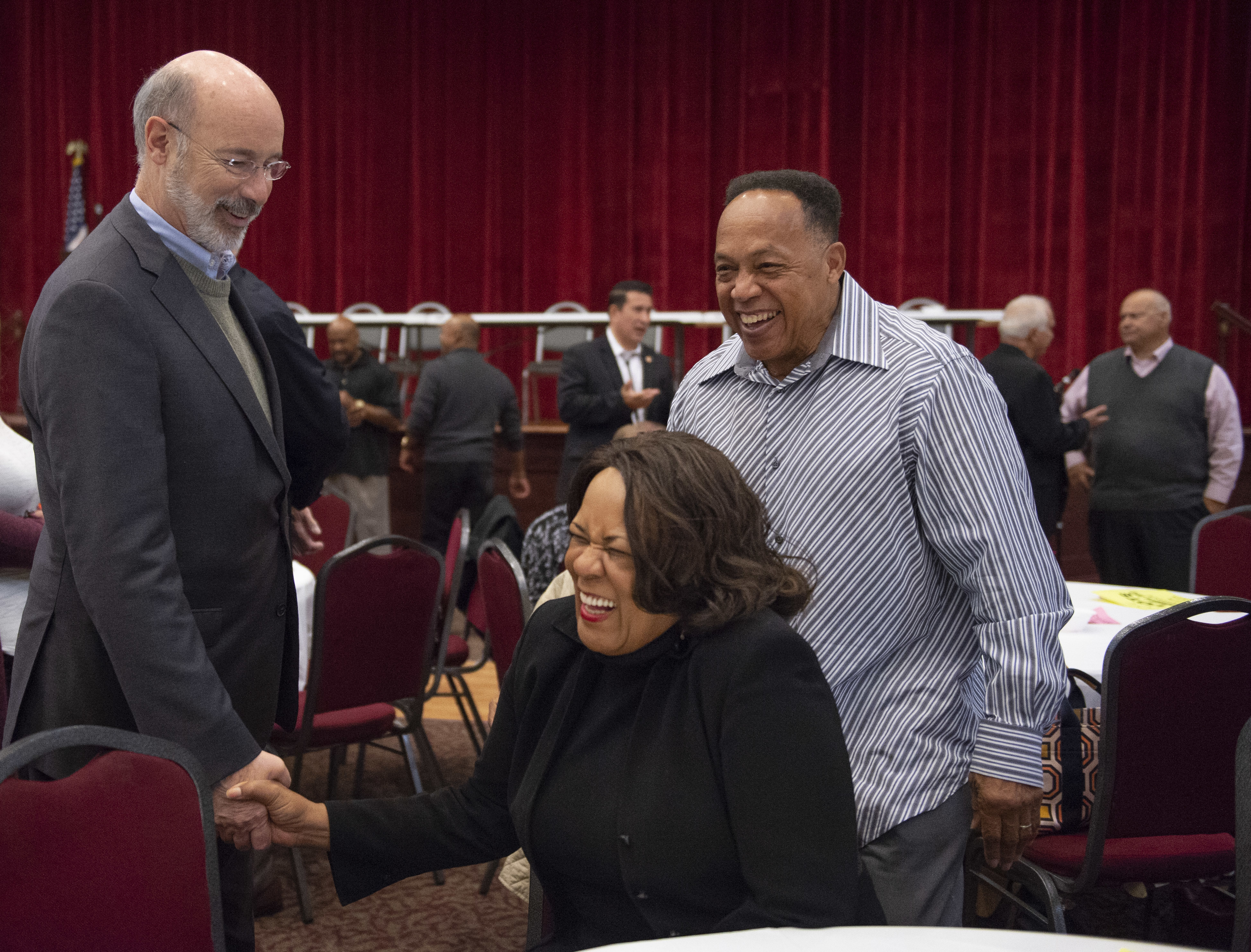 "Gov. Tom Wolf shakes hands with Mattie and Gerald Woods of Wilkinsburg during a ""Get Out the Vote"" rally on Saturday, Oct. 13, 2018, at Hosanna House in Wilkinsburg."