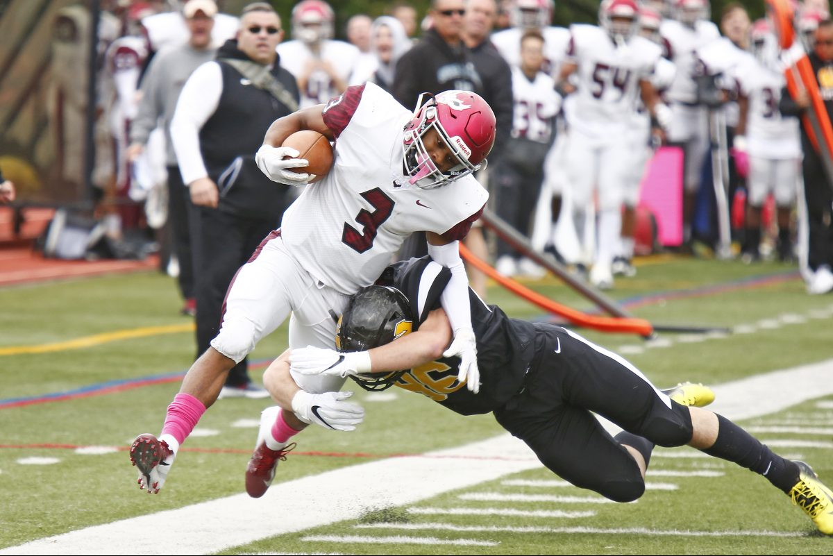 St. Joseph's Prep's Marques Mason is driven out of bounds by Archbishop Wood's Bill Cook after his 58-yard, first-quarter punt return.