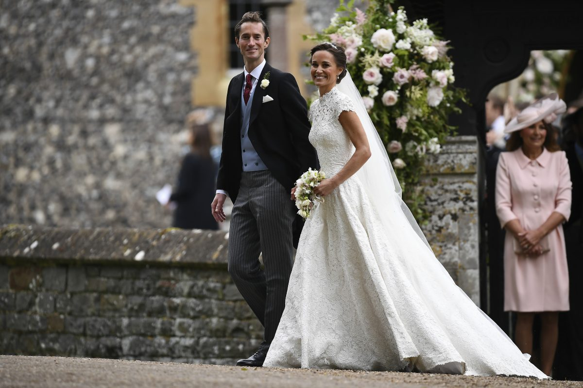 Pippa Middleton and husband James Matthews leave St. Mark Church in Englefield, west of London, on May 20, 2017 following their wedding ceremony  Saturday. Dress by British designer Giles Deacon
