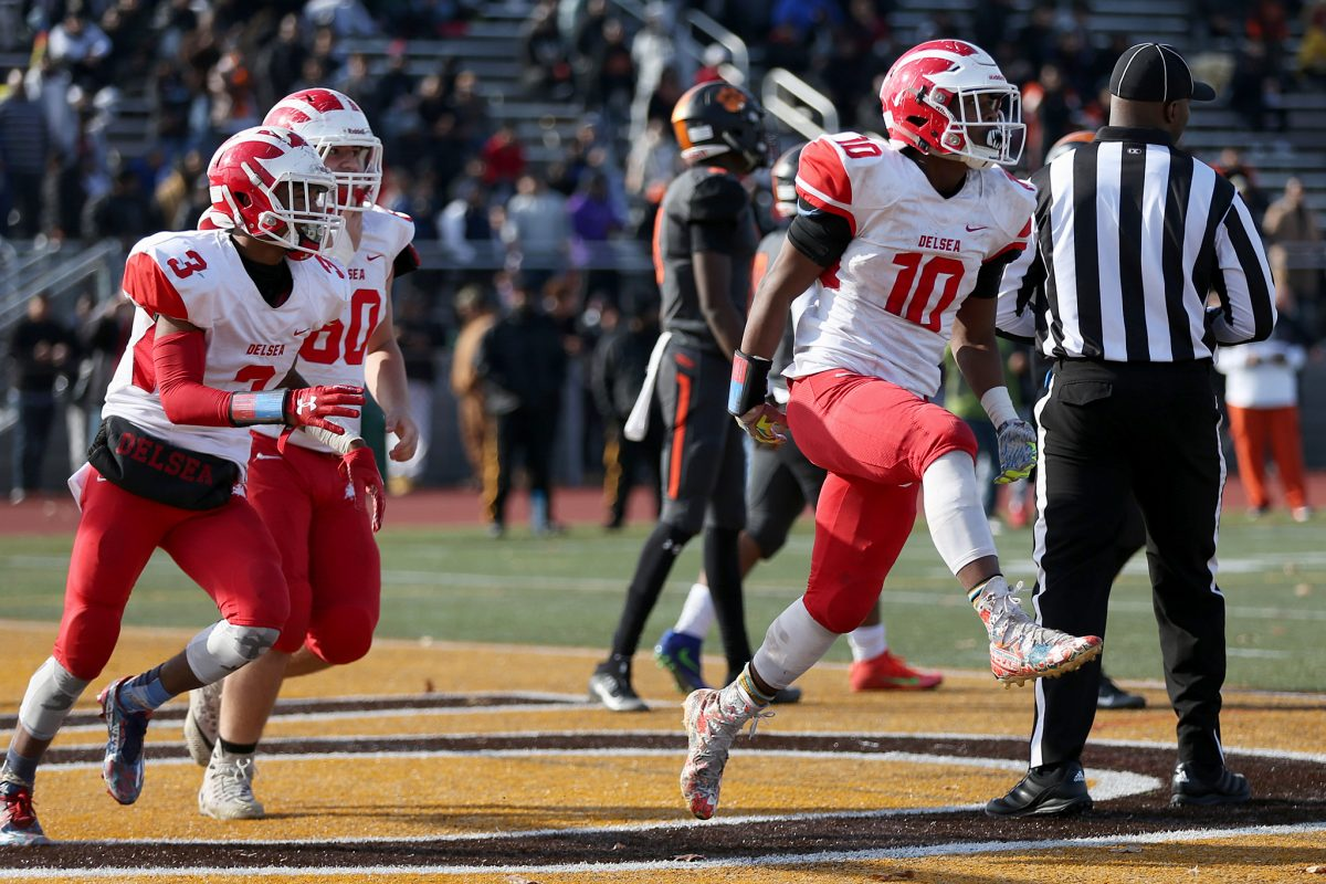 Delsea's Tymir Kizee (10) celebrates after scoring a touchdown in the second quarter of the South Jersey Group 3 championship game against Woodrow Wilson at Rowan University's Richard Wackar Stadium in Glassboro, N.J., on Saturday, Dec. 2, 2017. Delsea won 29-28.