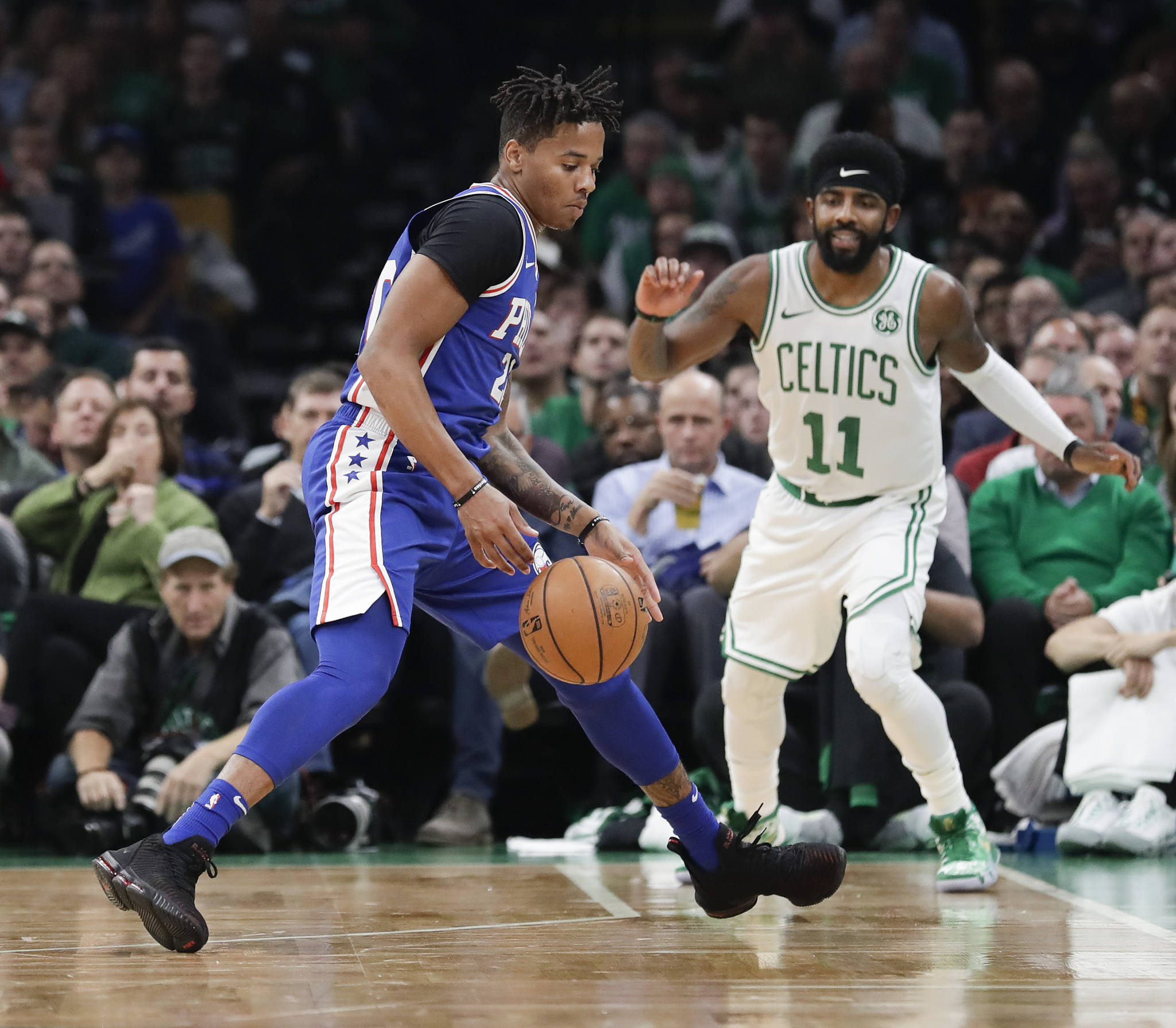 Sixers guard Markelle Fultz steals the basketball past Celtics guard Kyrie Irving.
