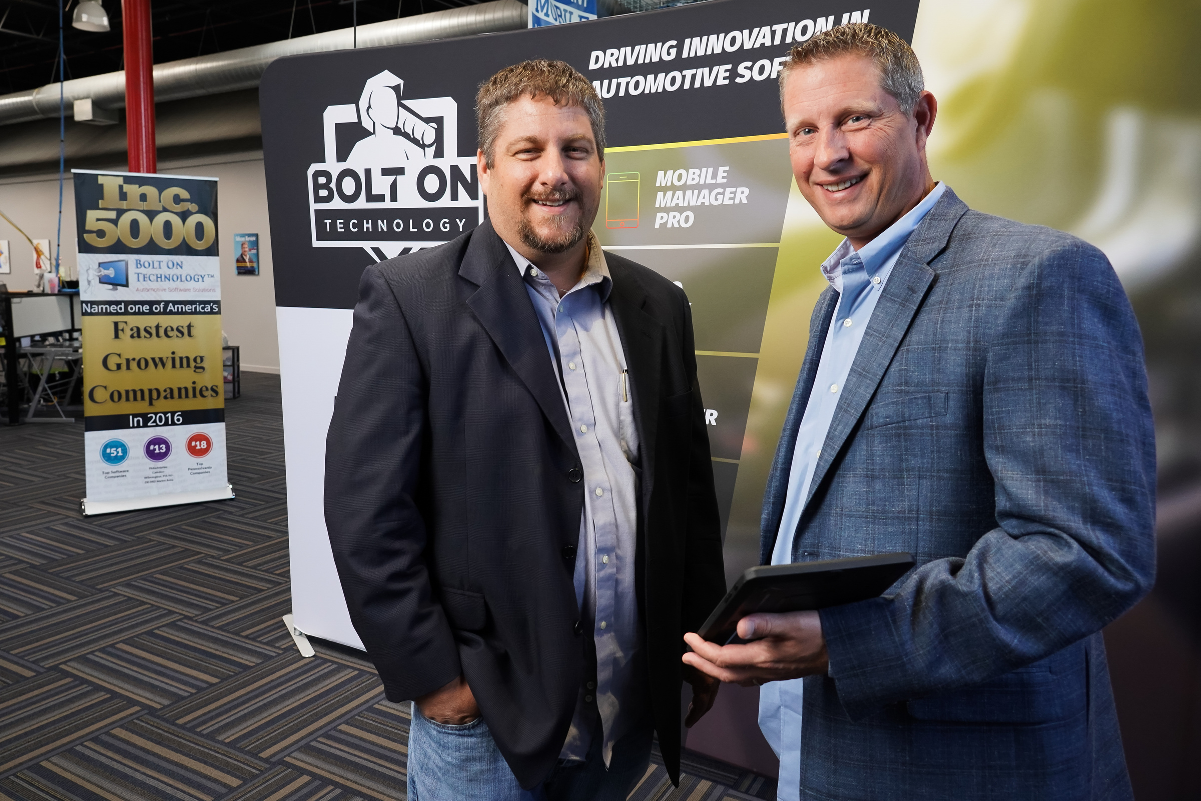 Michael Risich (left), founder and CEO of Bolt On Technology, and Frank Dragoni,, director of sales and corporate partnerships, at the 9-year-old company´s headquarters in Southampton, Bucks County.