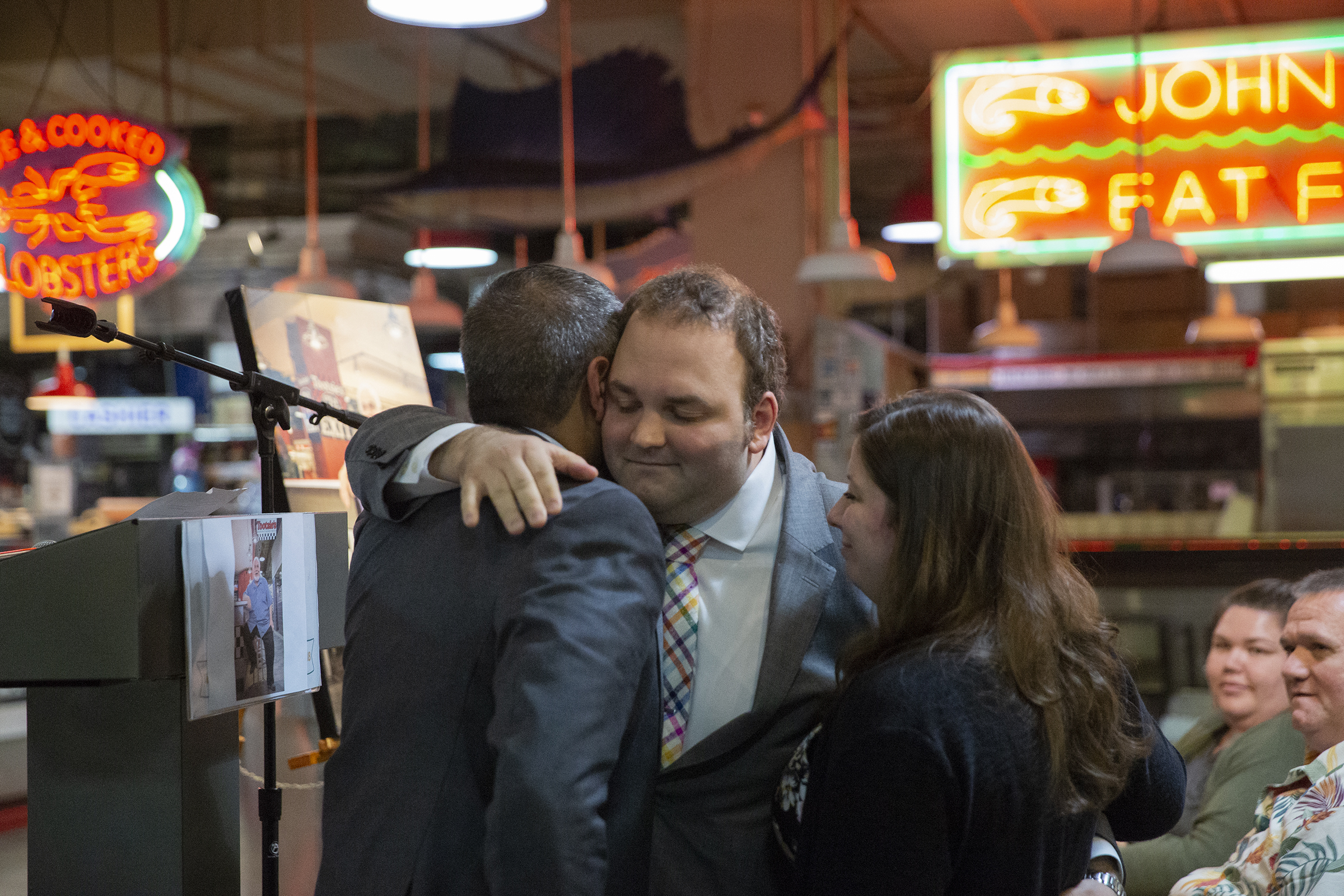 Alex Spataro hugs Anuj Gupta and his fiance, Caitlyn Davie, during a memorial service for his father Domenic, owner of Spataro´s Cheesesteaks.