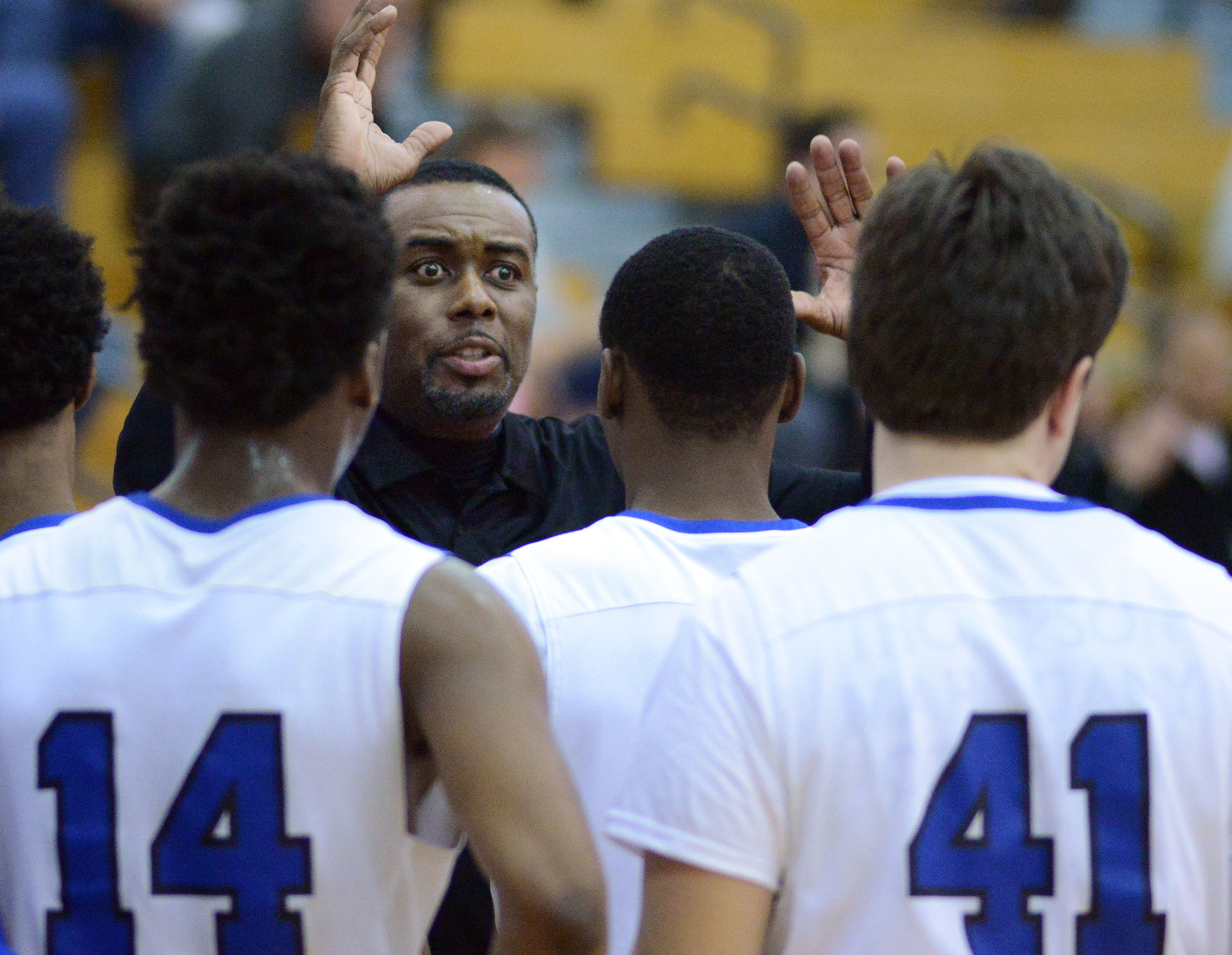 Bryan Caver talks to the Conwell-Egan players during a timeout in a PIAA Class 4A state playoff game against Bethlehem Catholic last season.
