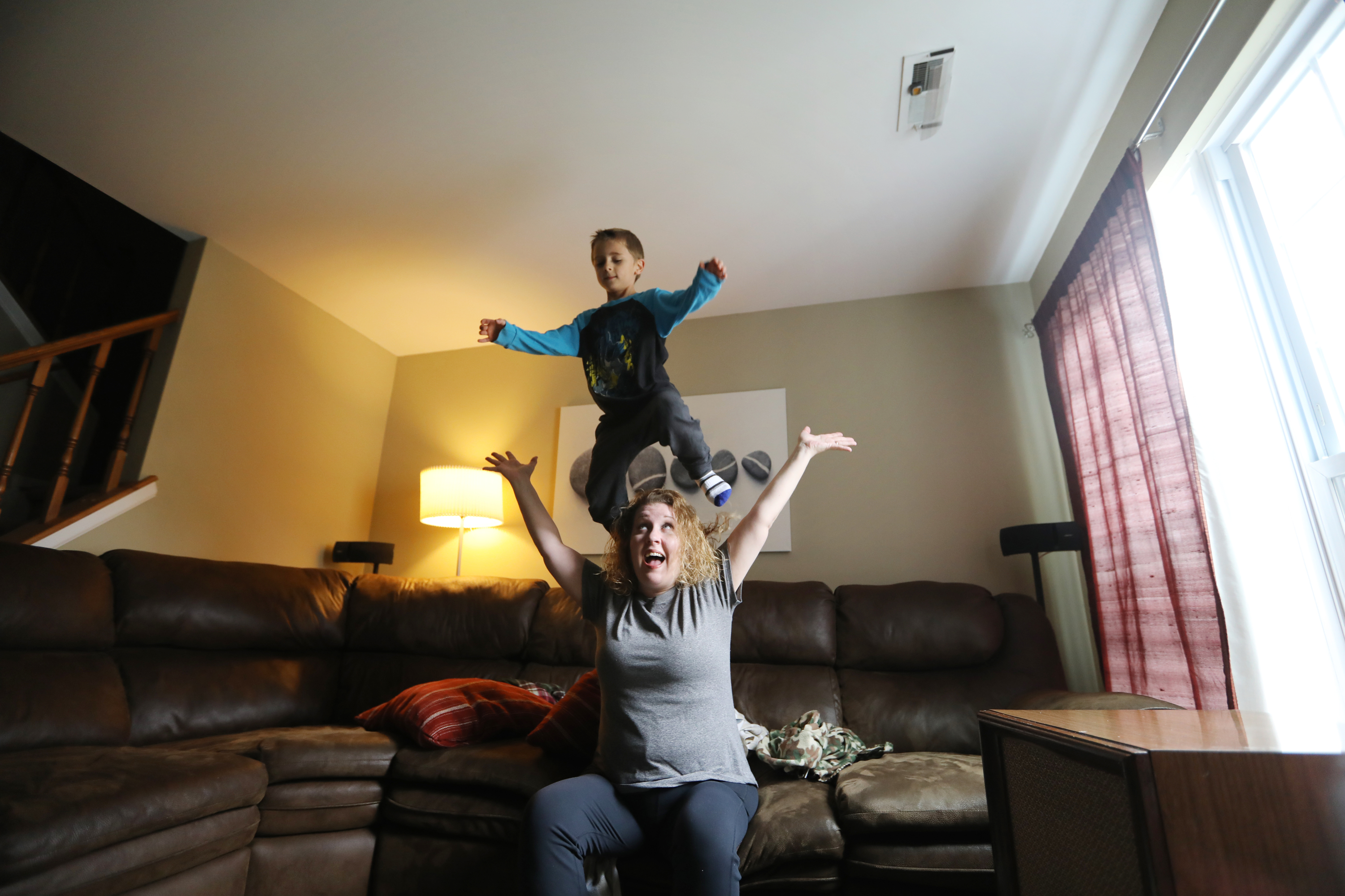 Nichole and Matthew Lowther play in their living room. Nichole wasn´t diagnosed with autism until her son Matthew, now 6, was diagnosed a few years ago.