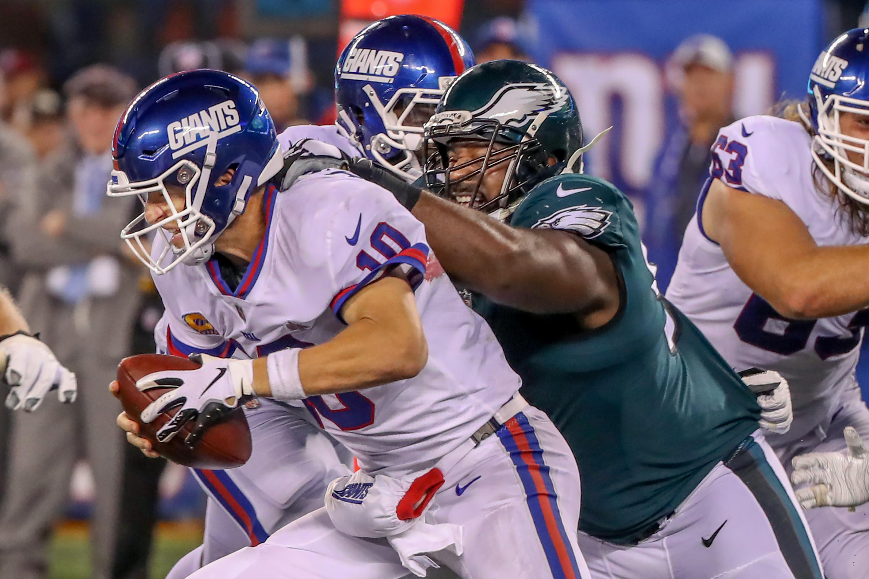 Eagle defensive tackle Fletcher Cox, right, grabs Giants quarterback Eli Manning and won�t let go. The Eagles beat Manning and the Giants last Thursday. 34-13.