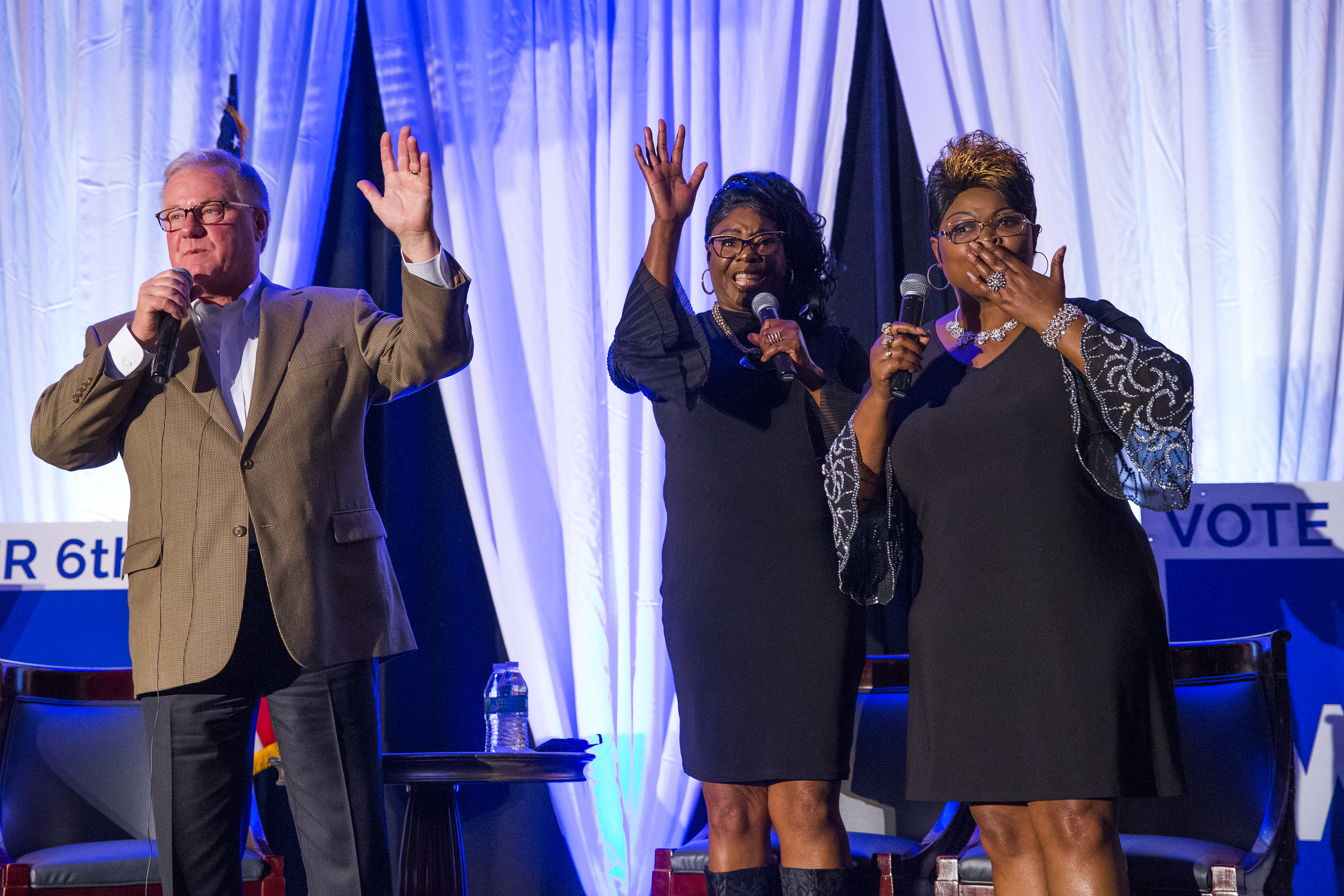 Republican gubernatorial nominee Scott Wagner, left, waves goodbye on stage during a Philadelphia campaign stop with the conservative icons known as Diamond (Lynnette Hardaway), center, and Silk (Rochelle Richardson) on Oct. 26, 2018.