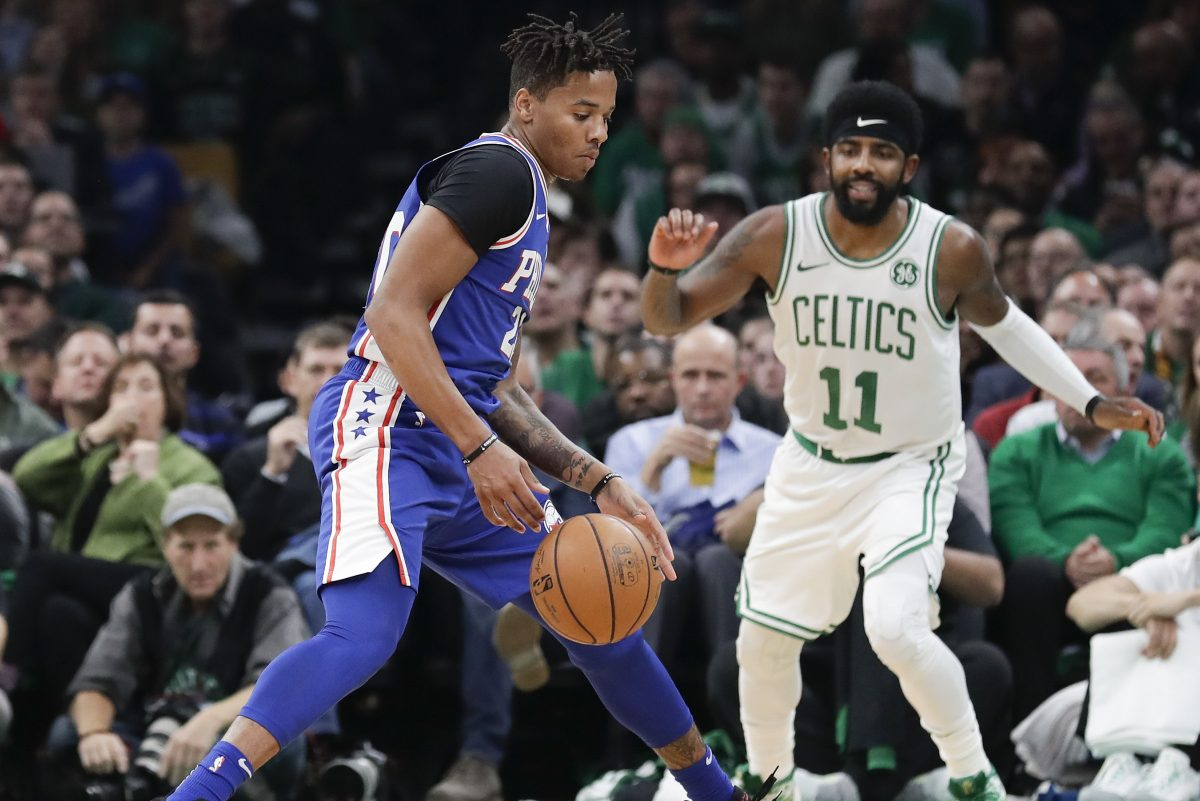 Sixers guard Markelle Fultz steals the basketball during the second-quarter past Boston Celtics guard Kyrie Irving on Tuesday, October 16, 2018 in Boston.