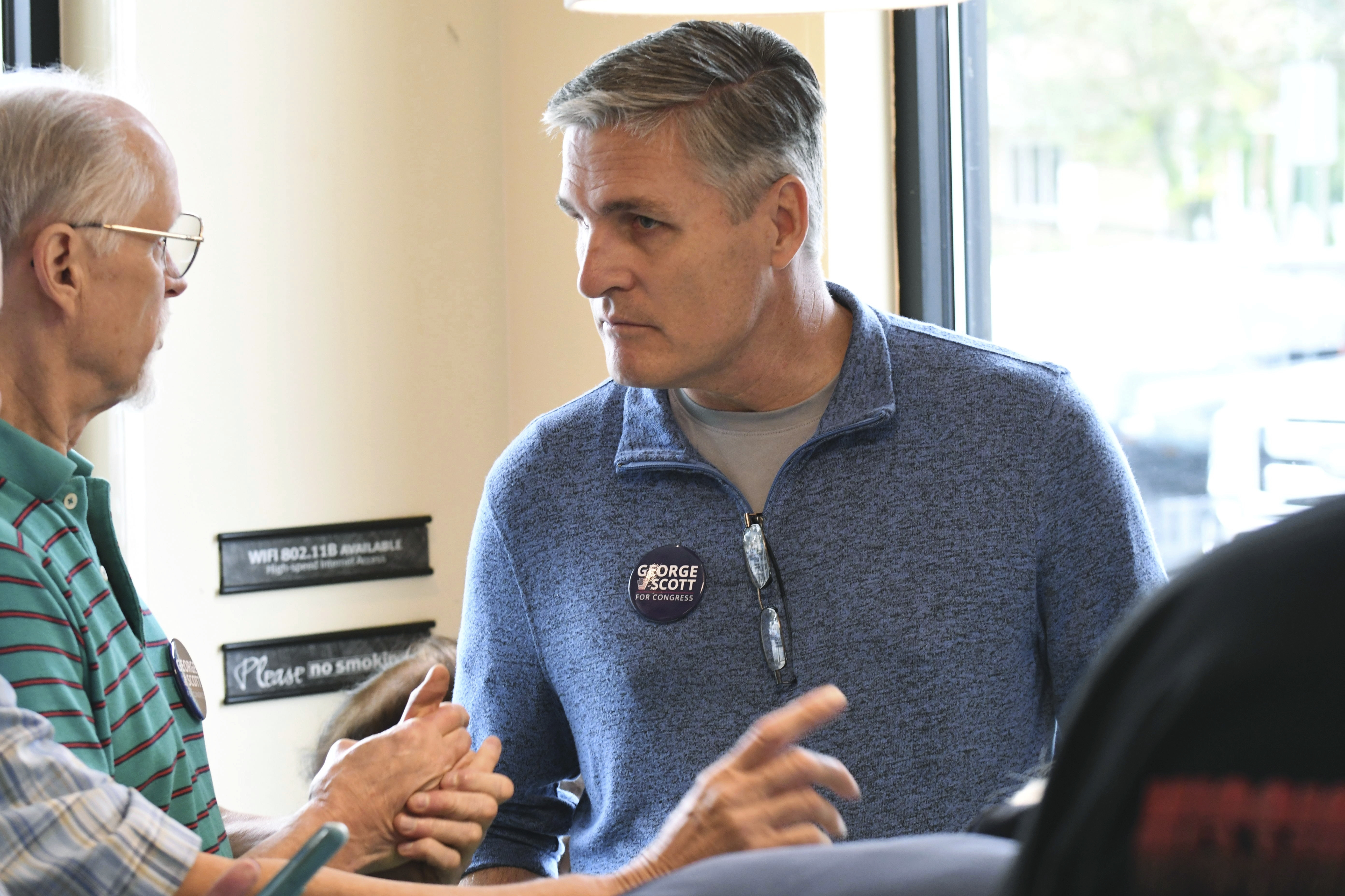 George Scott, the Democratic candidate for Congress in a Republican-leaning seat in central Pennsylvania, listens to volunteer canvassers in Camp Hill, Pa. on Oct. 6.