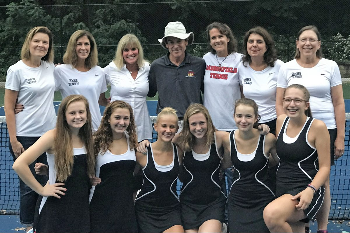 The Haddonfield moms and daughters with tennis coach Jeff Holman. Back row (from left) has Susan Parks, Karen Wallace, Susan Hodges, Holman, Deb Whiting, Joana McDonnell and Phoebe Figland. Bottom row has players (from left) Molly Parks, Lily Hanna, Paige Hodges, Becca Whiting, Alexandra McDonnell, and Gillian Rozenfeld.