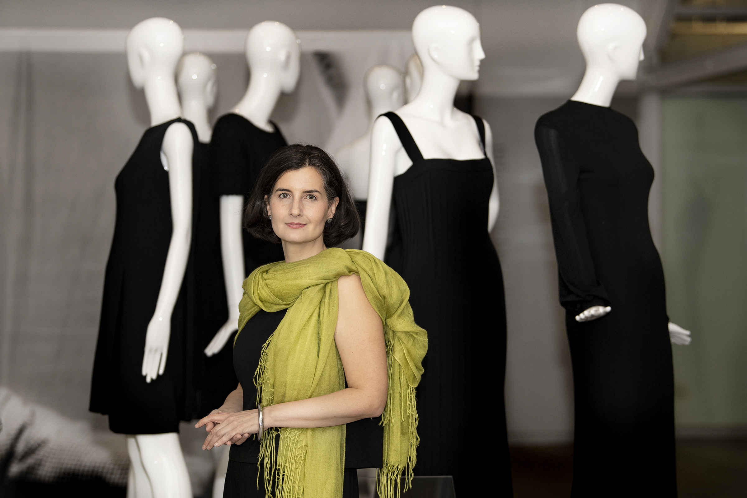 Clare Sauro, Curator, is photograph in front of couture dresses from the upcoming James Galliano´s exhibit at Drexel University´s Pearlstein Gallery in Philadelphia, Pa. Thursday, October,18, 2018. JOSE F. MORENO / Staff Photographer