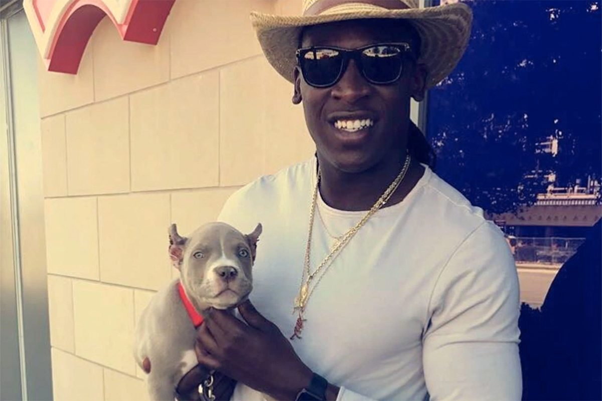 Cowboys wide receiver Luck Whitehead poses with his dog, Blitz. Blitz was kidnapped after a break-in on Sunday, but was returned by dognappers early Tuesday morning.