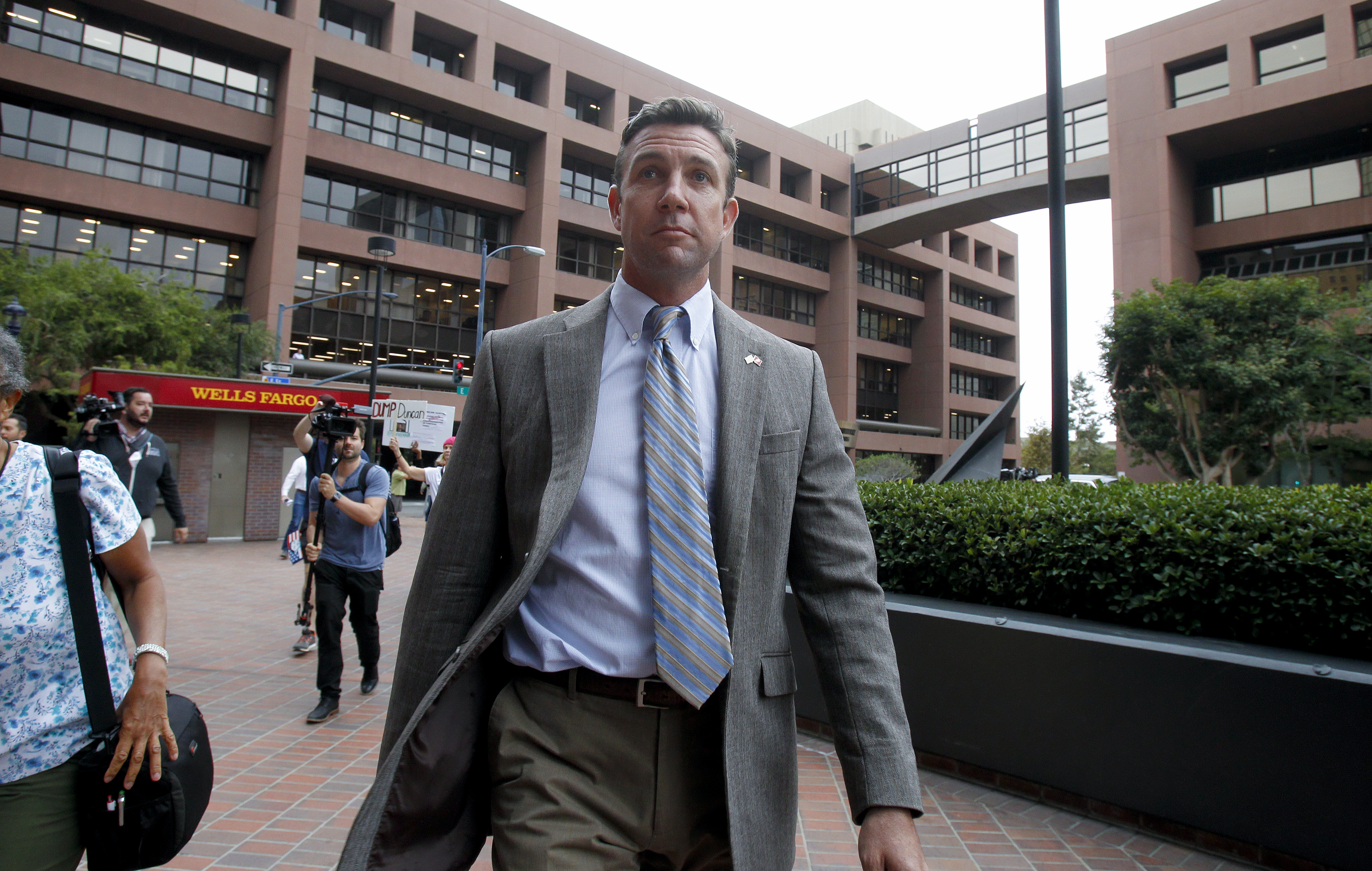 "Congressman Duncan Hunter leaves San Diego federal court on Sept. 24, 2018, where he and his wife, Margaret Hunter, appeared for a status hearing. They are charged with misspending political donations on personal items. Hunter is saying his opponent is a ""national security risk."""