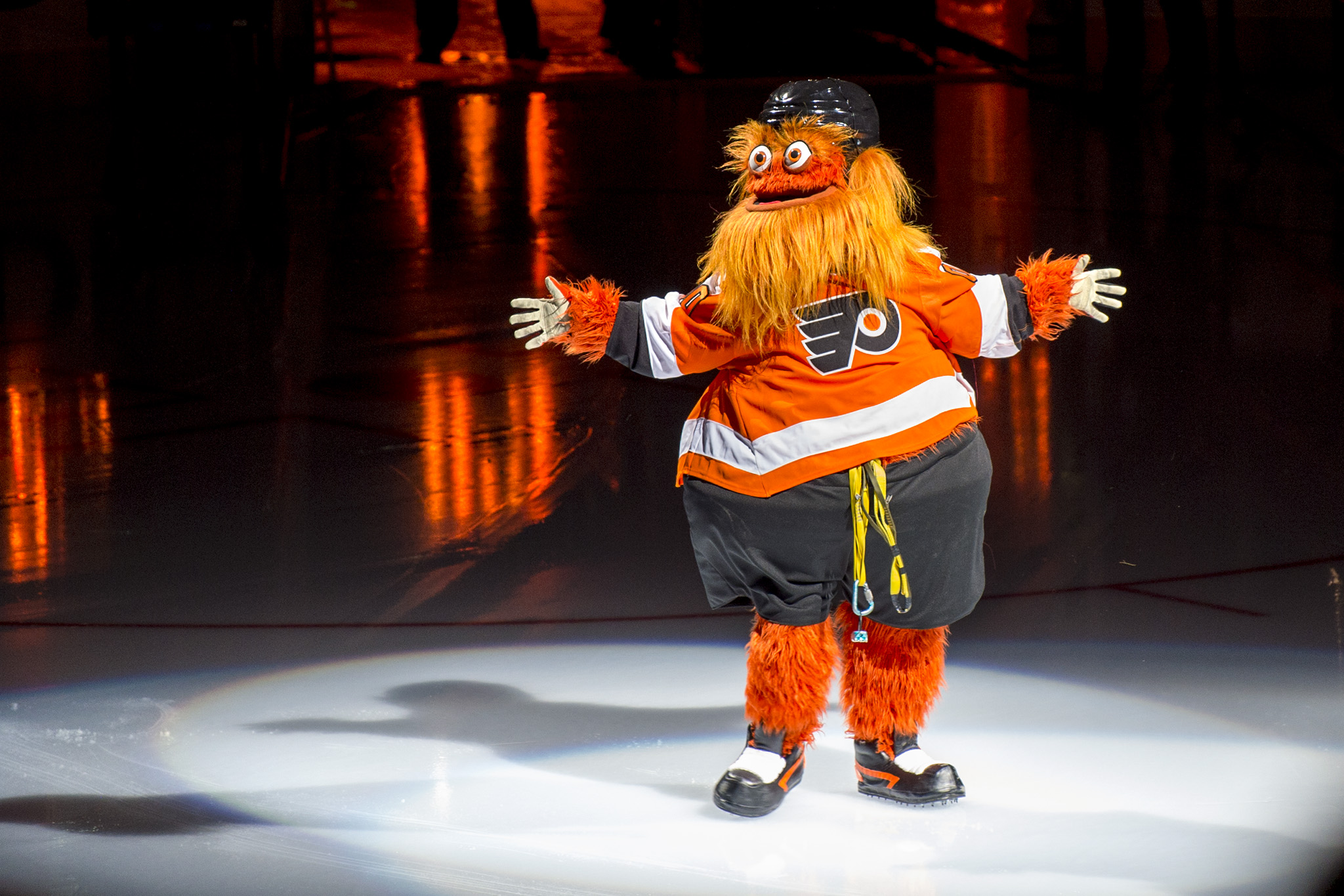 Gritty lands on the ice after making his appearance by rappelling down from the rafters.