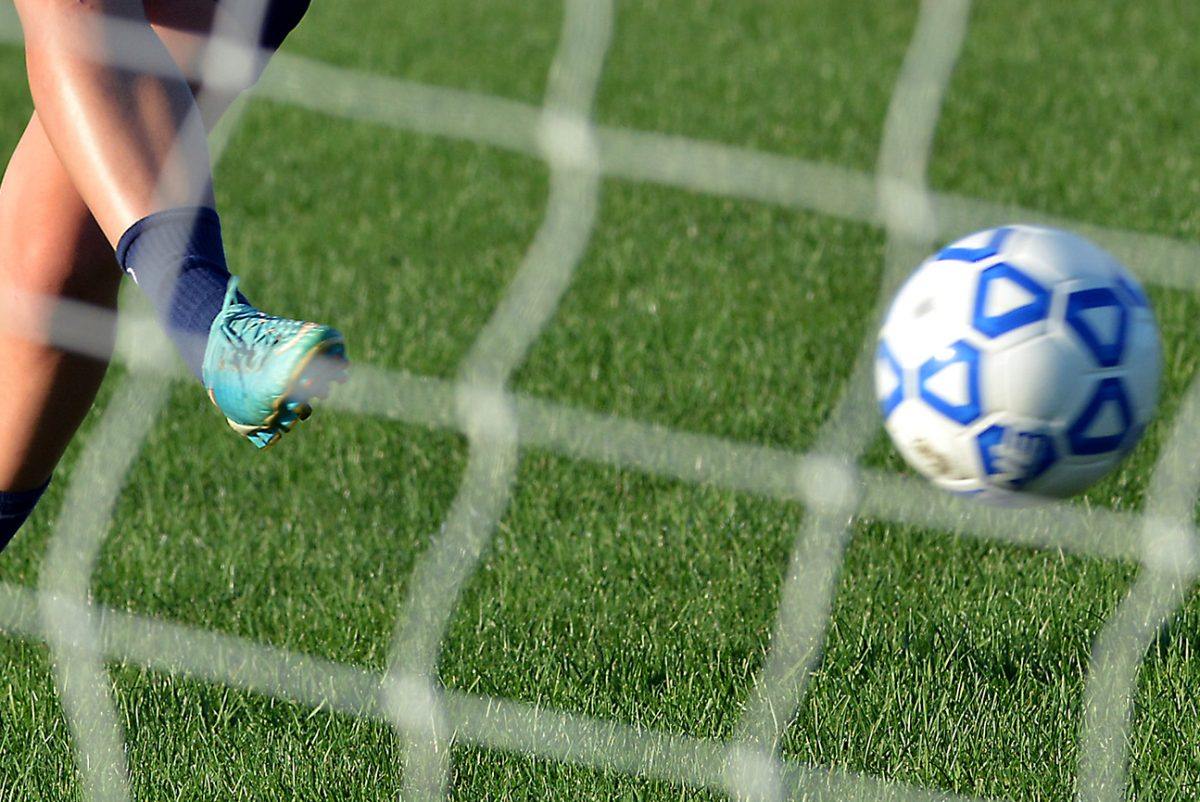 Washington Township High School soccer player Natasha Munro puts a shot on goal practicing with the team at the school on Monday September 4,2017. MARK C PSORAS/For the Inquirer
