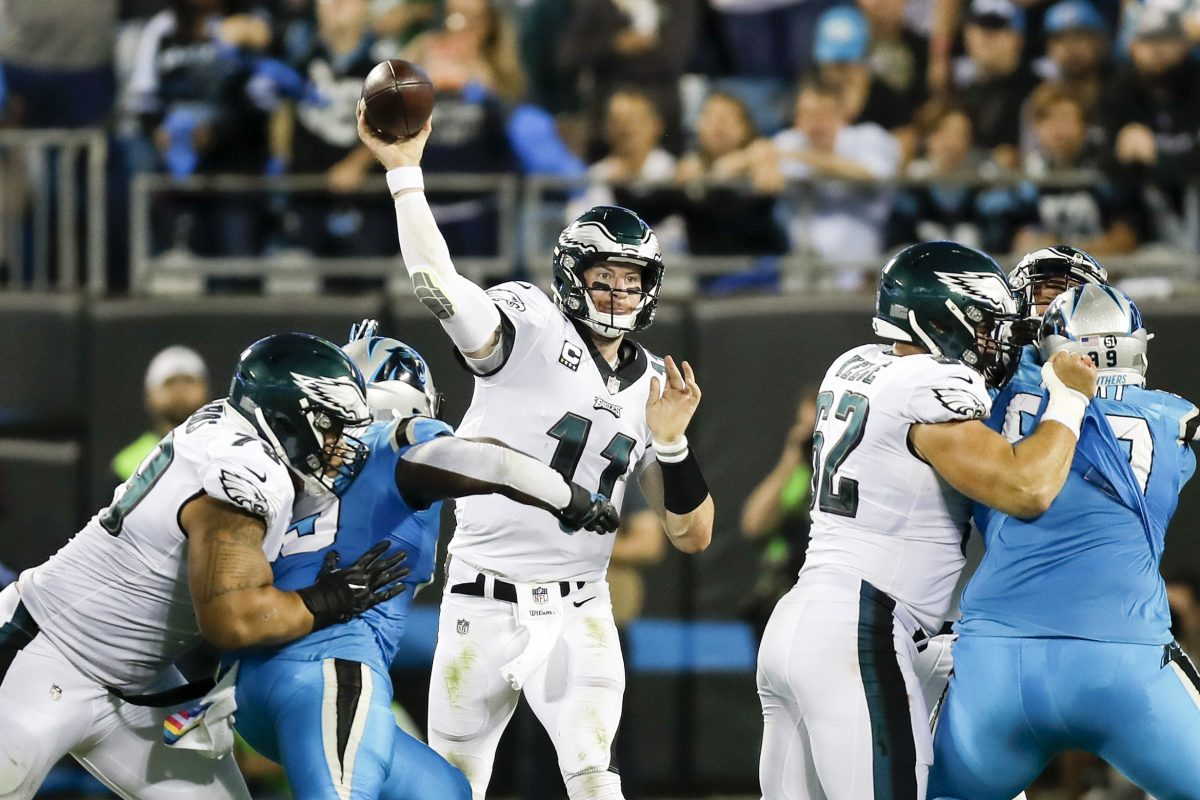 Eagles quarterback Carson Wentz throws the football against the Carolina Panthers on Thursday, October 12, 2017 in Charlotte, NC. YONG KIM / Staff Photographer
