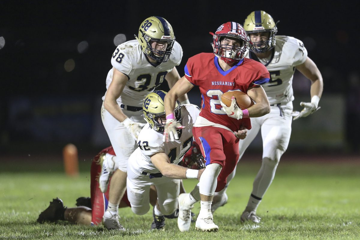 Neshaminy's Chris James breaks the tackle of Council Rock South's Eric Woloshyn (42) for a short gain in the Redskins' 9-0 victory in Langhorne.