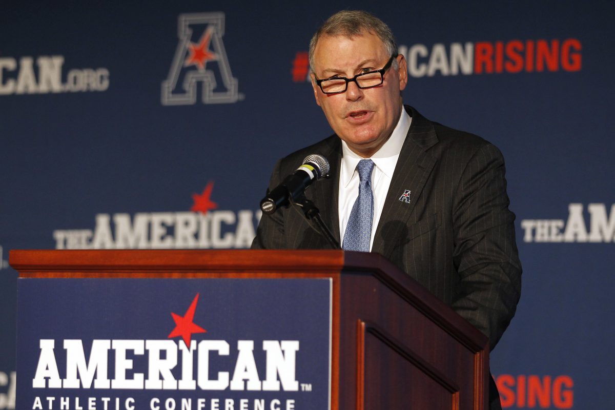 American Athletic Conference commissioner Mike Aresco, shown in 2015, said Temple and Miami will play in football, but nothing is official yet.