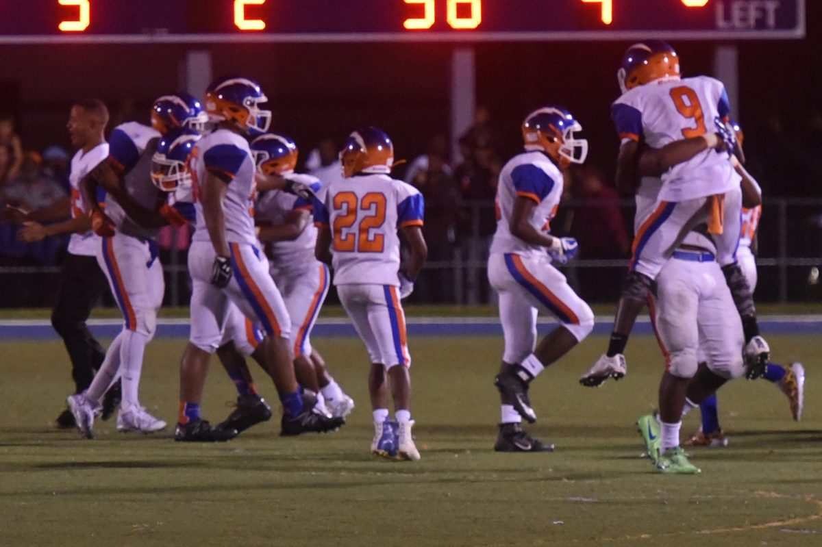 JAUG23P Millville football players celebrate their last-minute win ,at St. Augustine. They scored a TD with 25 seconds to go, ,and then, the defense held. Photo / Curt Hudson,,,,,,,,,,,,,,,,,,,,,,,,,,,,,,,,,,,,,,,,,,,,,