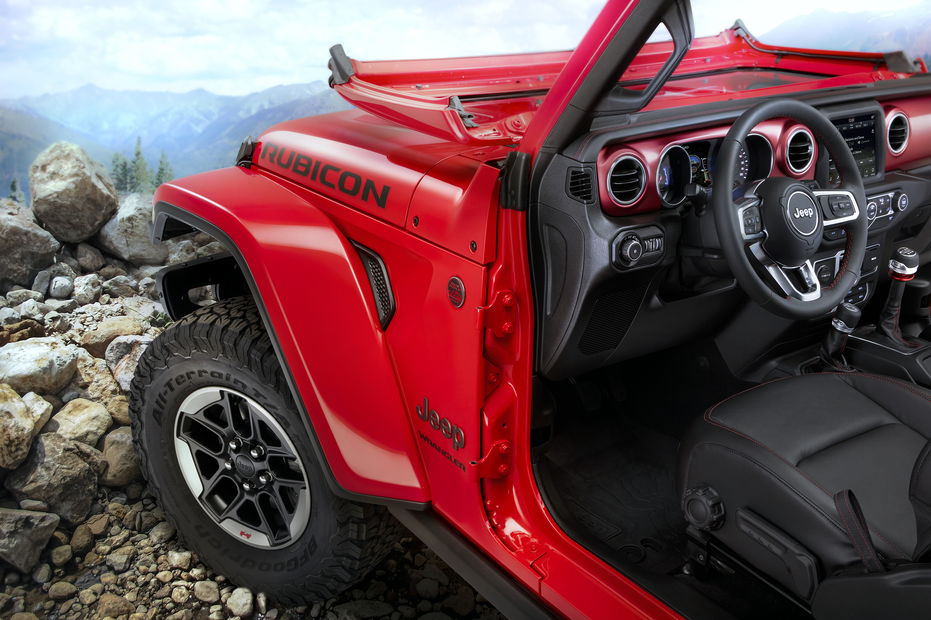The interior of the 2018 Jeep Wrangler JL mixes modern technology with traditional touches — and comes off a winner.