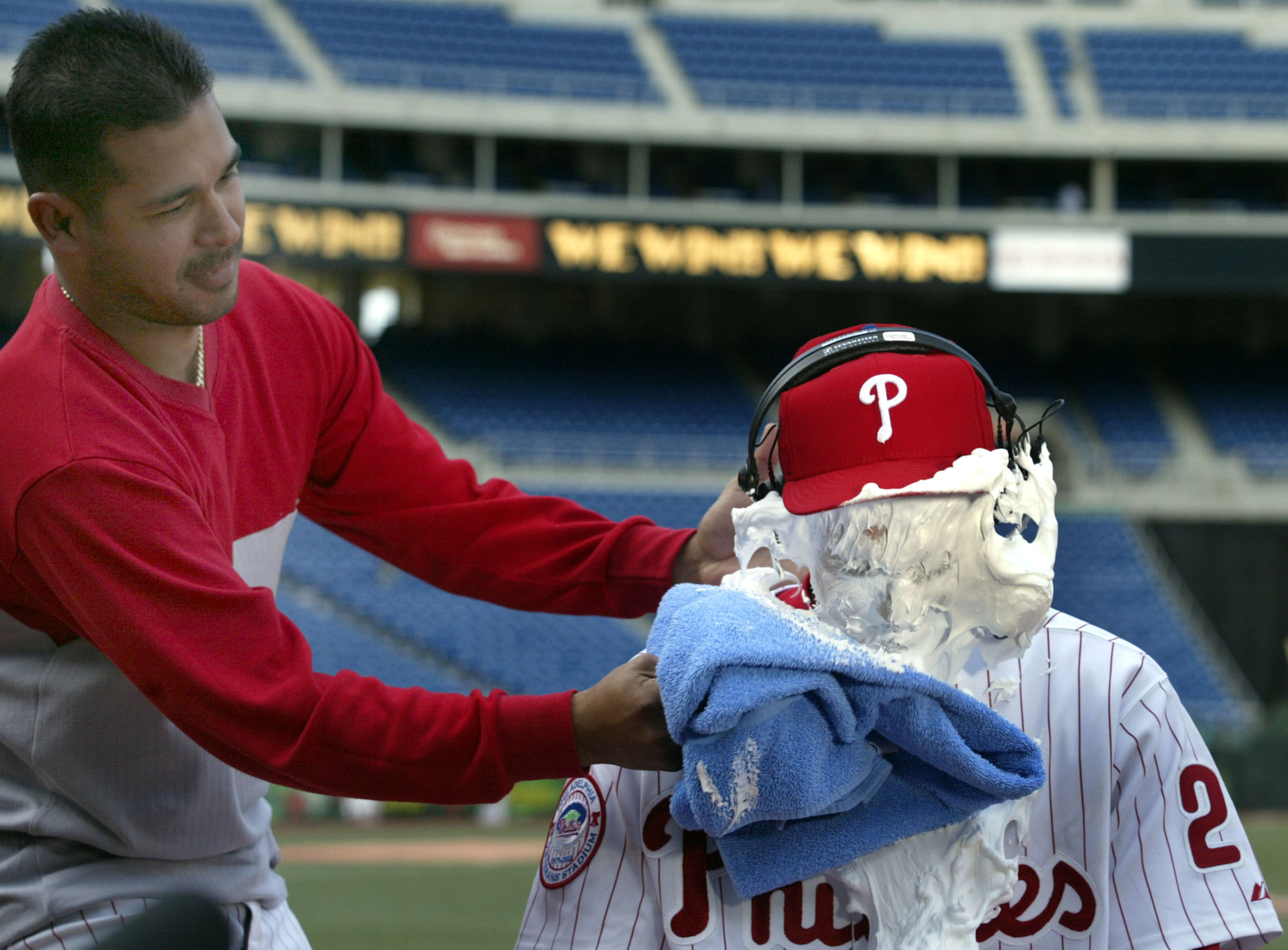 Phillies/Rockies game action. Phillies Chase Utley gets pied by Tomas Perez during an interview after the game where he hit his first major league homer/hit and grand slam in the 3rd inning off Rockies Aaron Cook. 04/24/03 DN Steven M. Falk