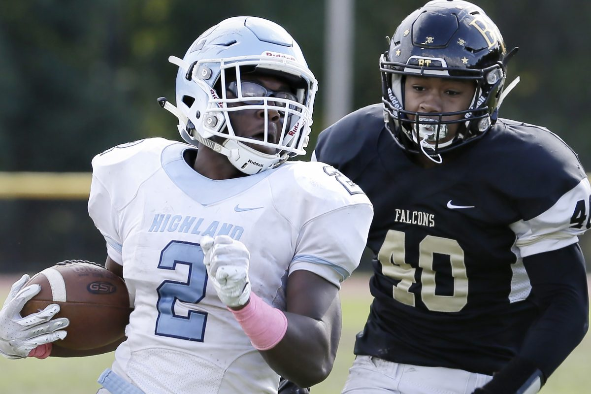 Highland's Johnny Martin (2) looks over his shoulder at Burlington Township's Xavier Morgan.