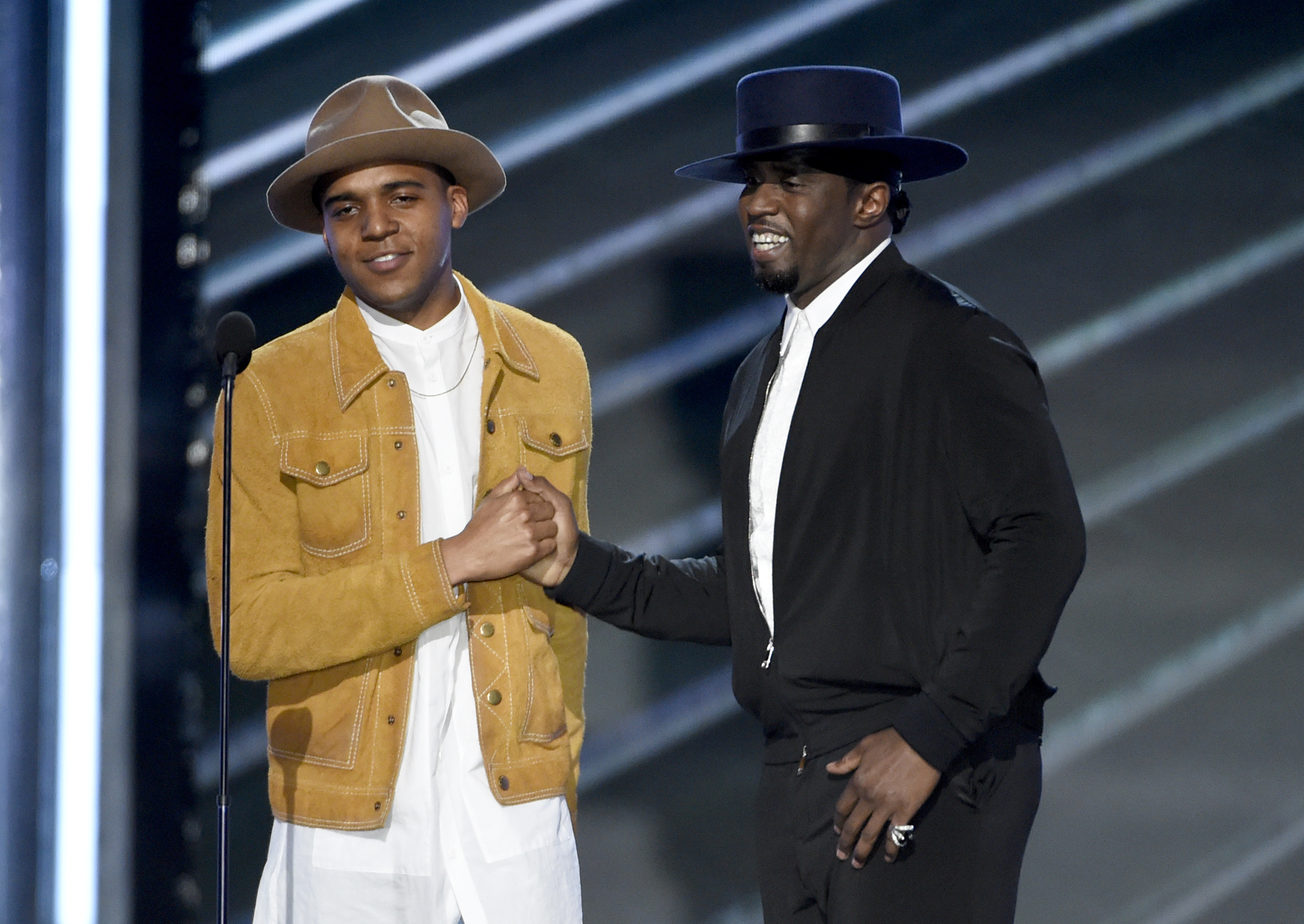 "Christopher Jordan Wallace, son of Notorious B.I.G., left, and Sean ""Diddy"" Combs present a tribute to Notorious B.I.G. at the Billboard Music Awards at the T-Mobile Arena on Sunday, May 21, 2017, in Las Vegas. (Photo by Chris Pizzello/Invision/AP)"