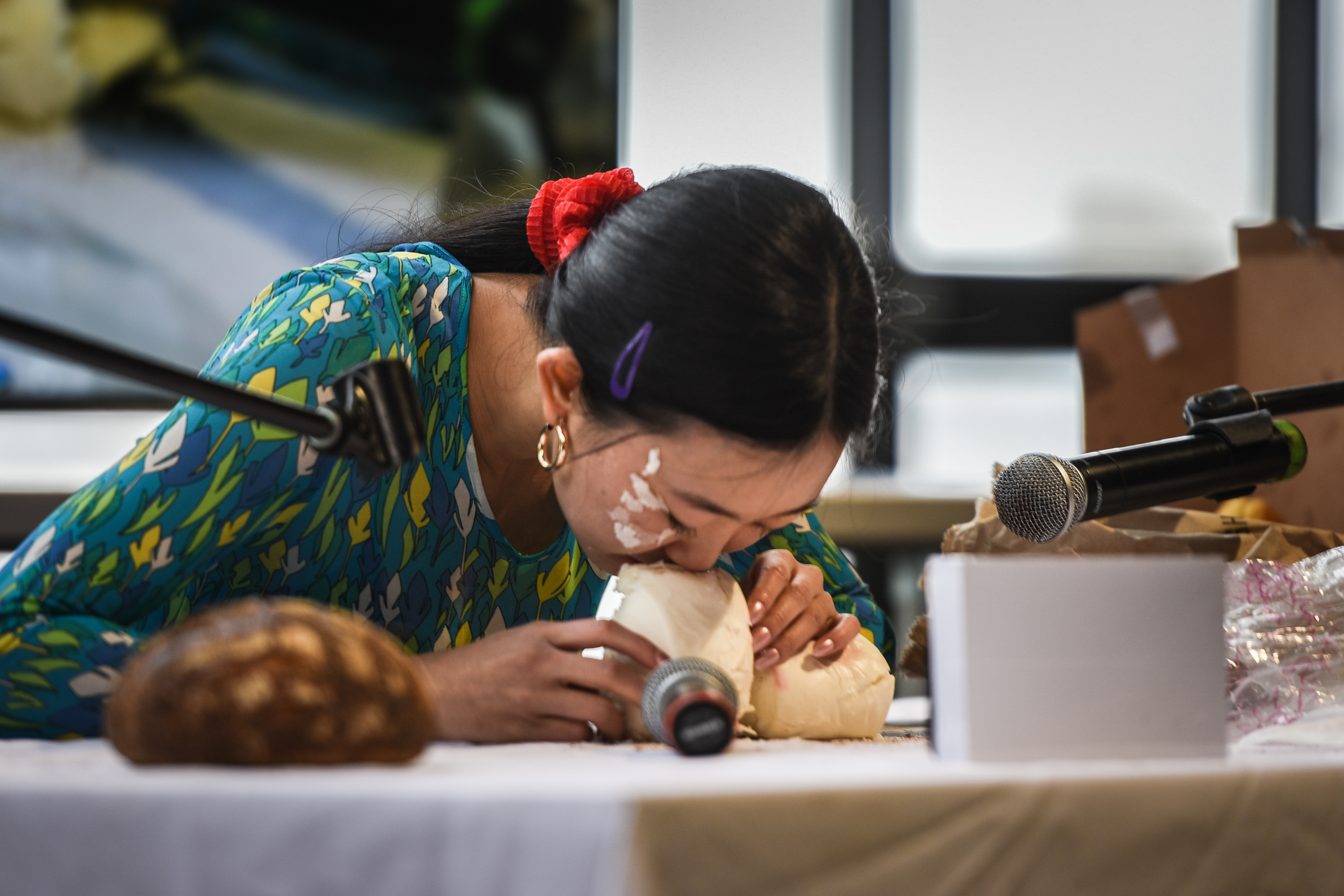 """On October 27, 2018 Philadelphia Contemporary hosted Philadelphia´s festival for autonomous sensory meridian response (ASMR). Pictured here is the woman behind the Instagram account """"Bread Face,"""" she has garnered over 200 thousand followers by posting videos of her smashing her face into loafs of bread."""