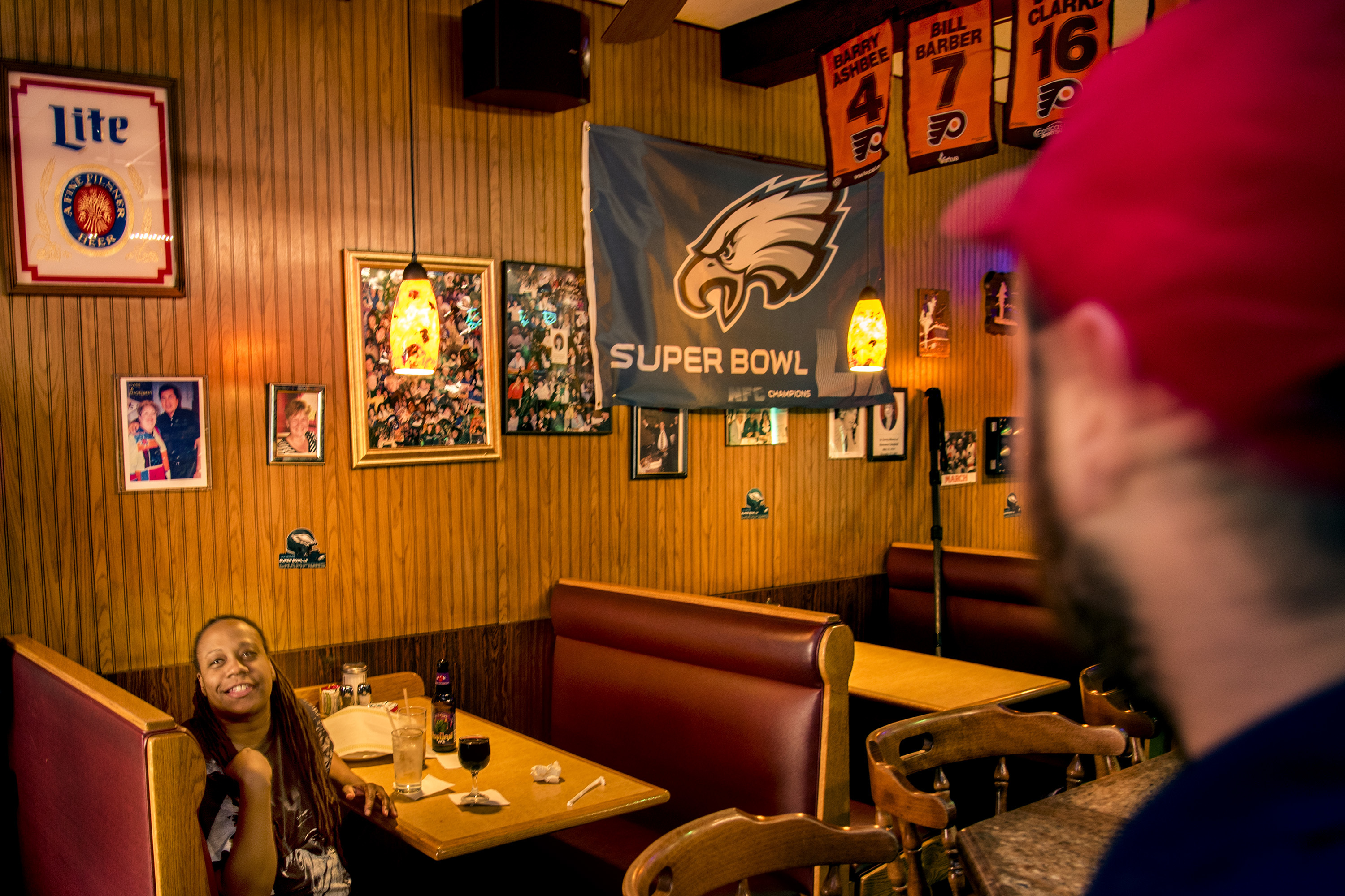 Regulars Maria Boyd (left) and Travis Hopkins (right) talk in the bar at the Midtown III.