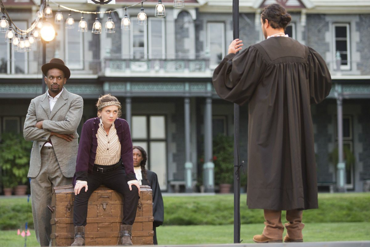 """(Left to right:) Carlo Campbell as Exeter, Emilie Krause as Henry, Savannah Jackson as Ely, and Guillermo Alonso as Canterbury in the Delaware Shakespeare production of """"HenryV,"""" through July 30 at Rockwood Park, Wilmington."""