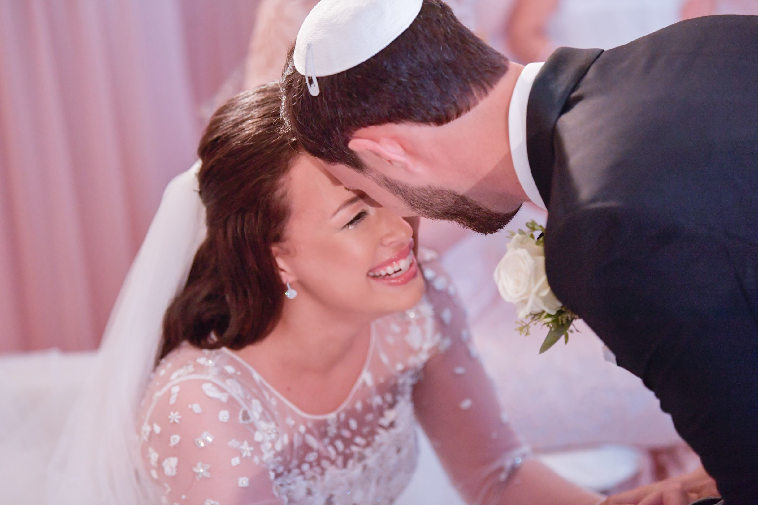 Arielle Belfer and Jacob Wischnia share a special moment at the veiling ceremony.