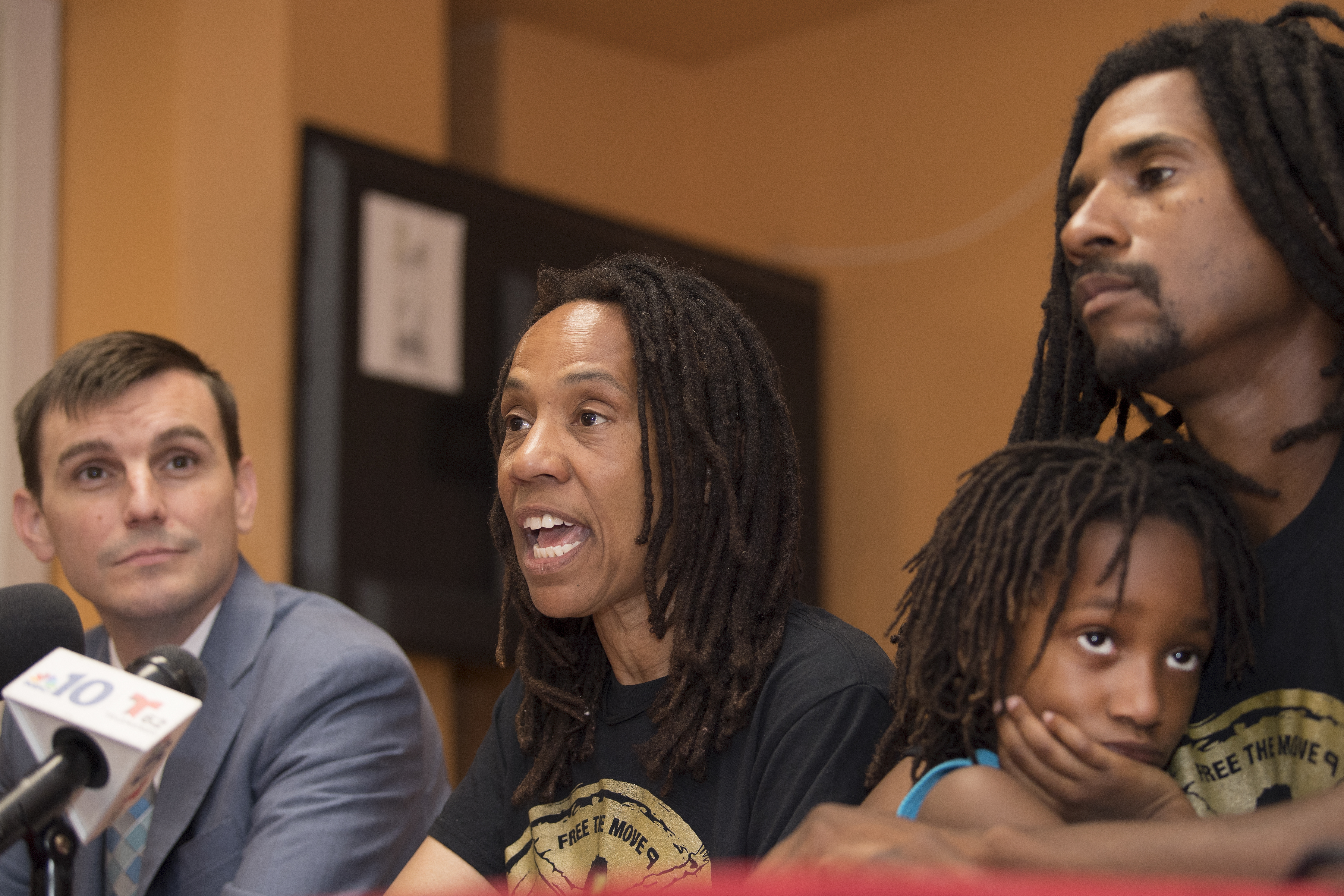 Attorney Brad Thomson, Debbie Africa, Alia Africa, (granddaughter) and Mike Africa, son, speaks to the media during her first public appearance at the Faith Immanuel Lutheran Church, in East Lansdowne, Pennsylvania. Tuesday, June 19, 2018. The first MOVE member was granted parole, after 38 years in prison.