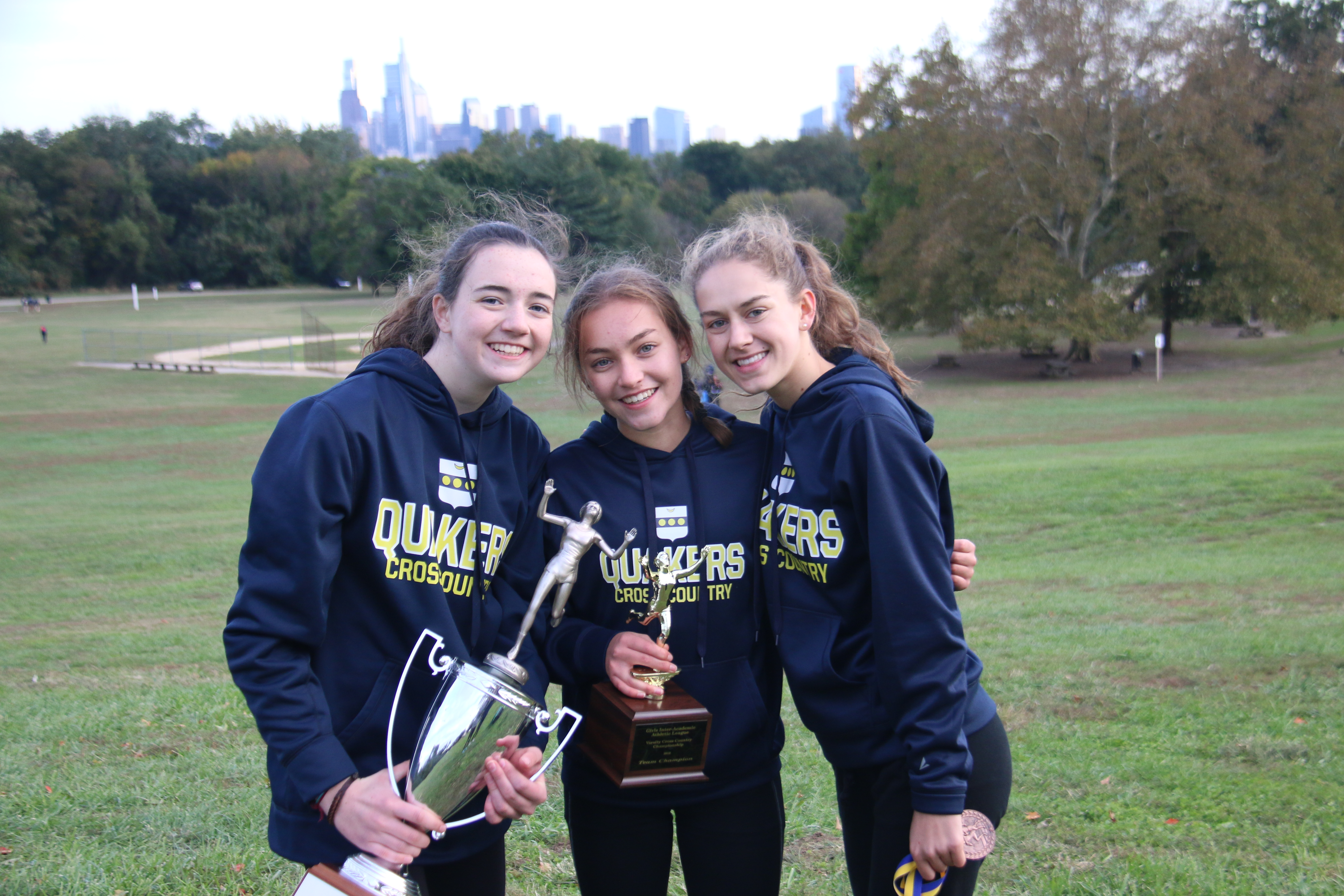Abby Zwall (middle) poses with teammates after the team won the Inter-Ac League title.