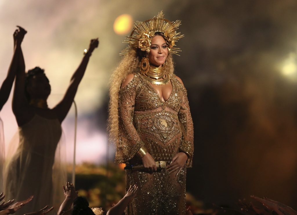 FILE – This Feb. 12, 2017, file photo shows Beyonce performing at the 59th annual Grammy Awards in Los Angeles. Beyonce debuted her newborn twins Sir Carter and Rumi in an Instagram post on July 13, 2017.