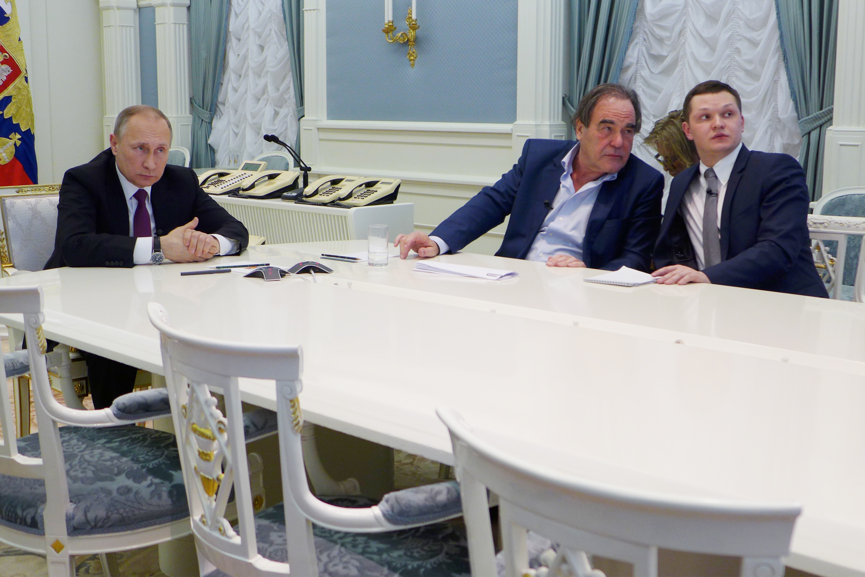 A still from the Showtime documentary THE PUTIN INTERVIEWS. - Photo: Komandir/Courtesy of SHOWTIME Pictured: Russian President Vladimir Putin, Oliver Stone, interpreter Sergei Chudinov.