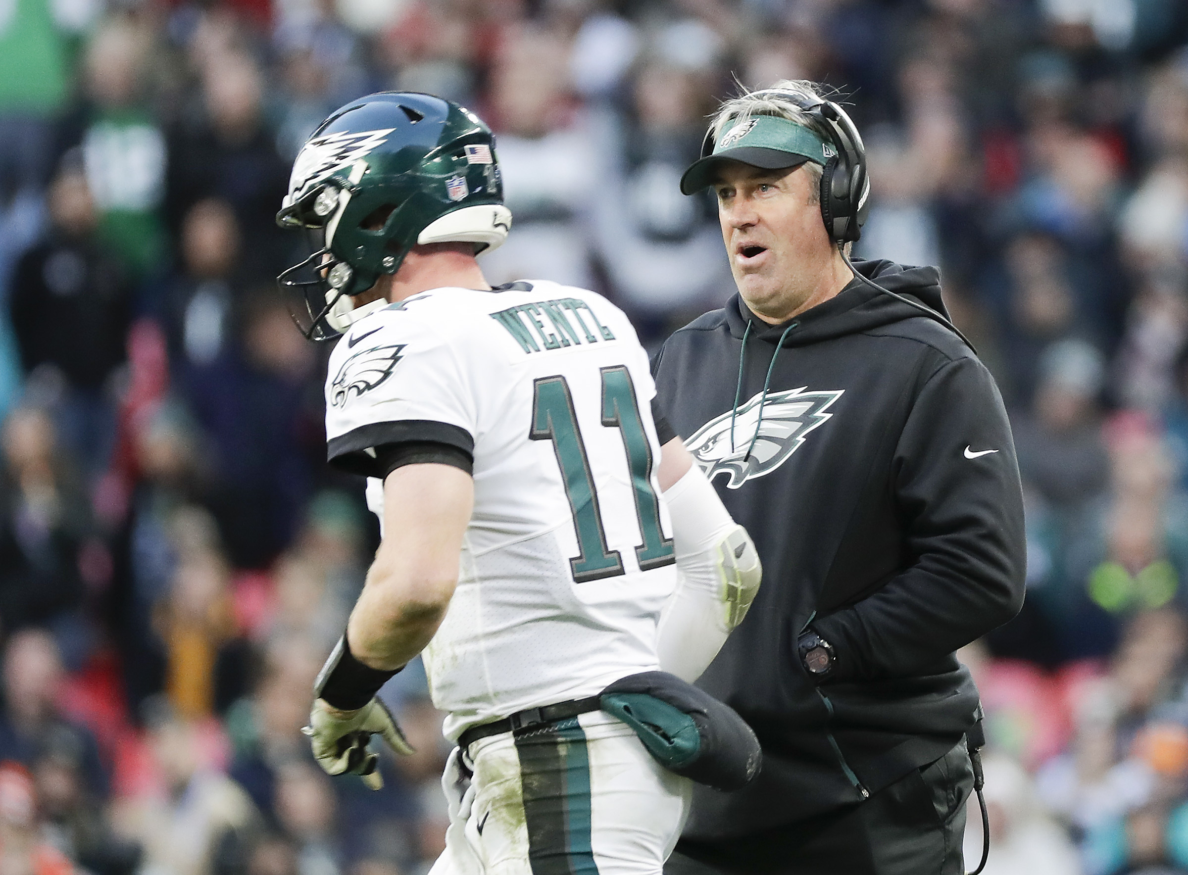 Eagles coach Doug Pederson looks at quarterback Carson Wentz late in the game against Jacksonville.