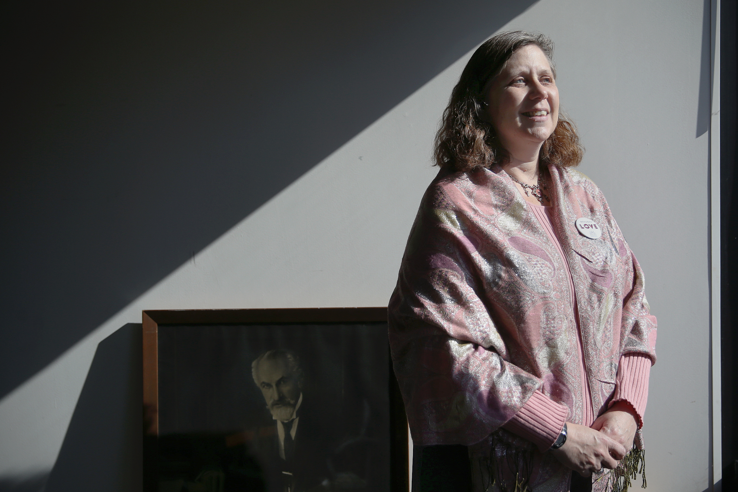 HIAS Pennsylvania Executive Director Cathryn Miller-Wilson stands for a portrait in her office in Philadelphia.