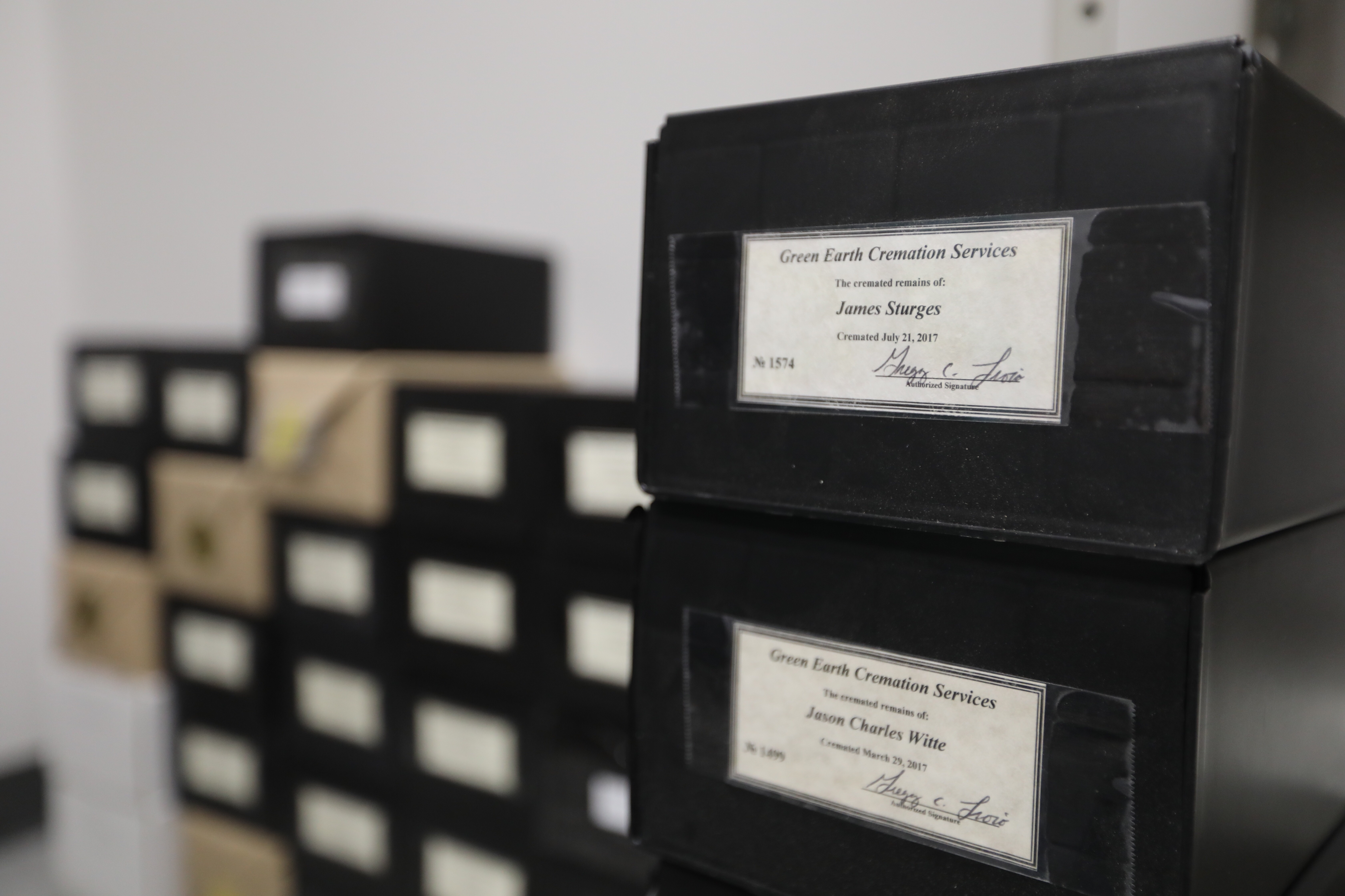 The cremated remains of dozens of unclaimed dead people are stored in these plastic boxes inside the Chester County Coroner´s Office, in some cases for many years.