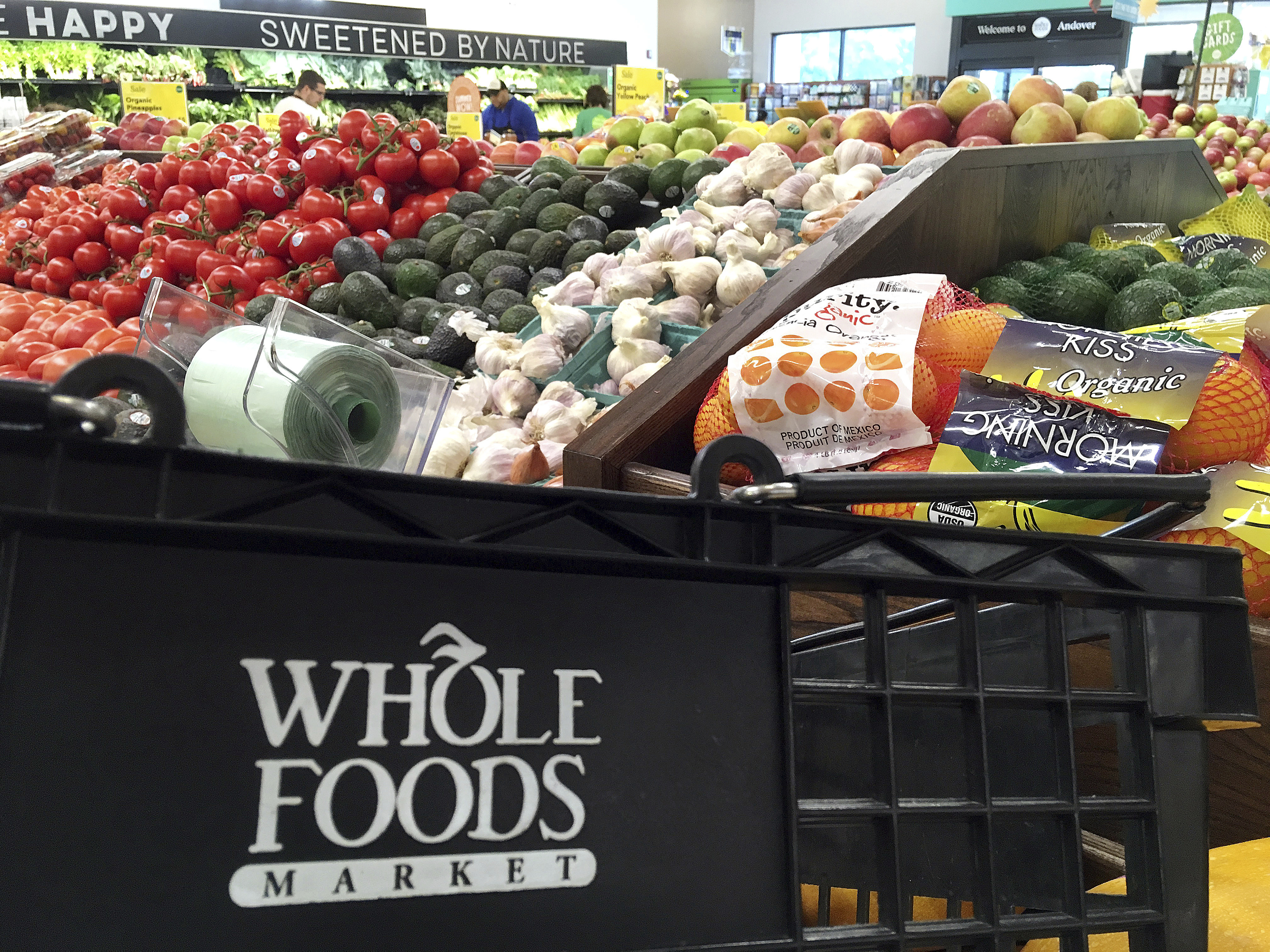 .In this June 5, 2017 photo, produce is displayed at Whole Foods Market in Andover, Mass. Amazon is acquiring Whole Foods for $13.7 billion, or $42 a share. (AP Photo/Elise Amendola)