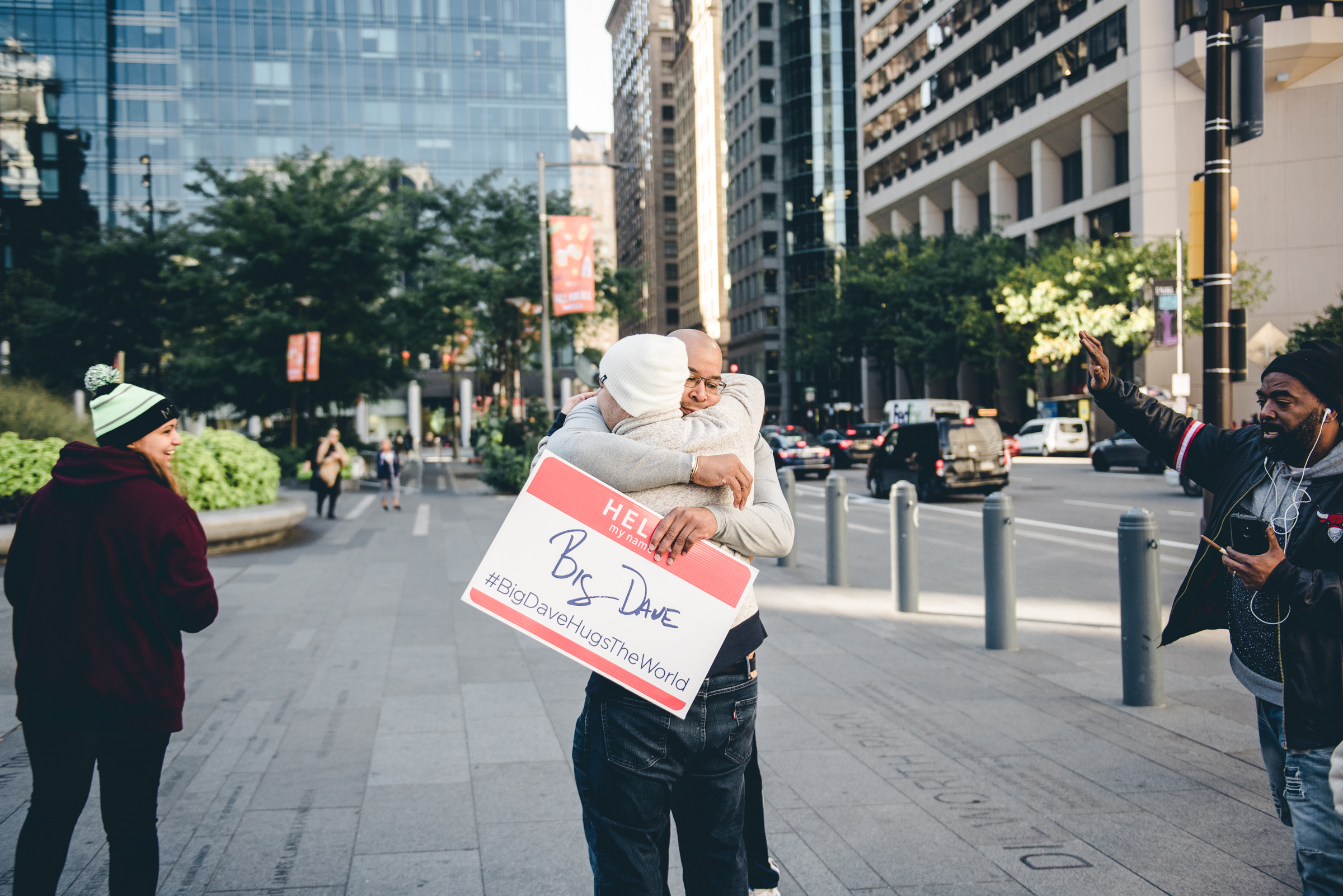 Big Dave estimates around one third of those passing by come in for a hug. Some leave in tears, as the small gesture proves its power in being able to elicit an emotional moment.