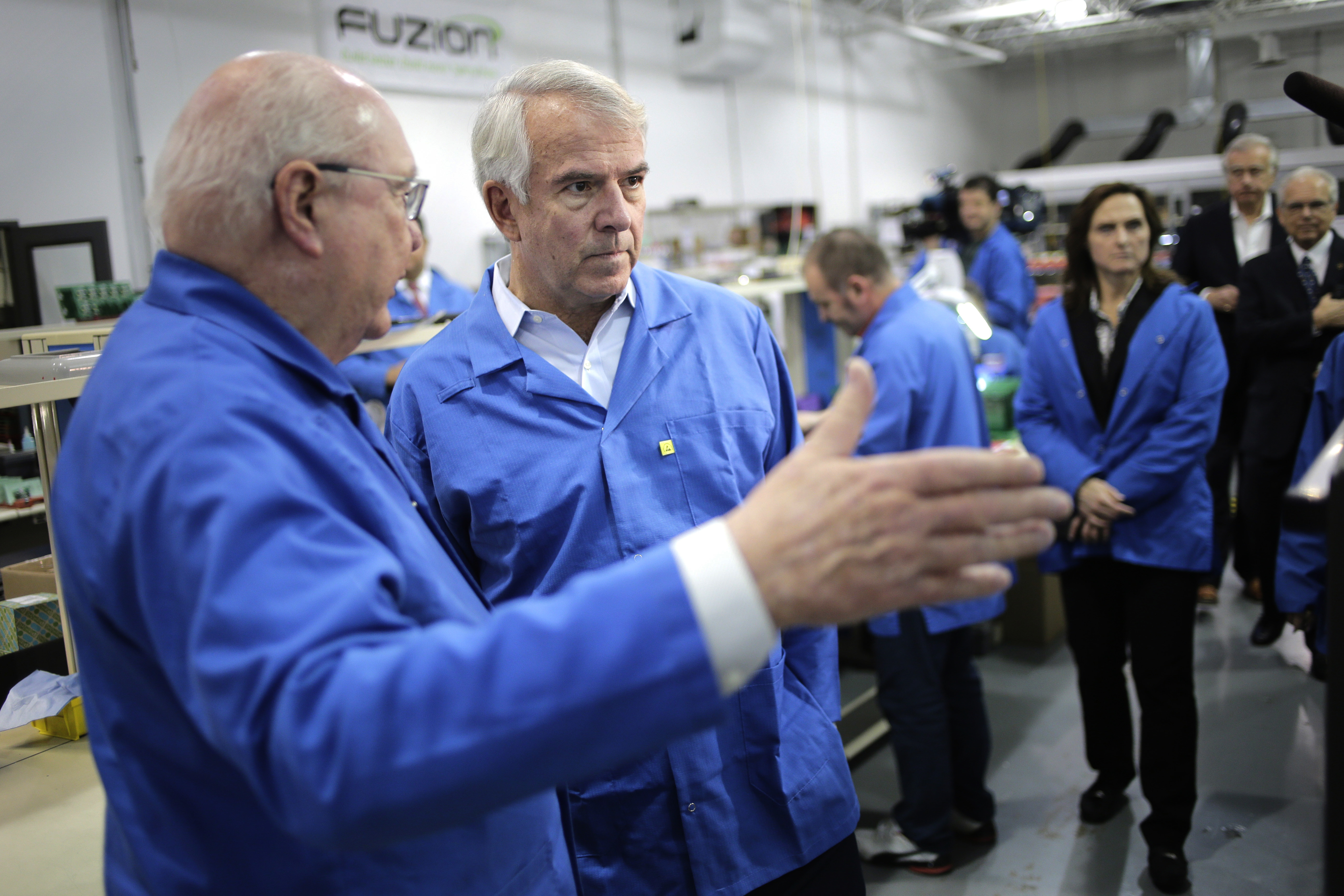 Republican Bob Hugin, center, takes a tour of American Patriot Solutions in Rockaway, N.J., Tuesday, Oct. 30, 2018. Hugin, a former drug company executive, is running for Senate against Democrat Bob Menendez.