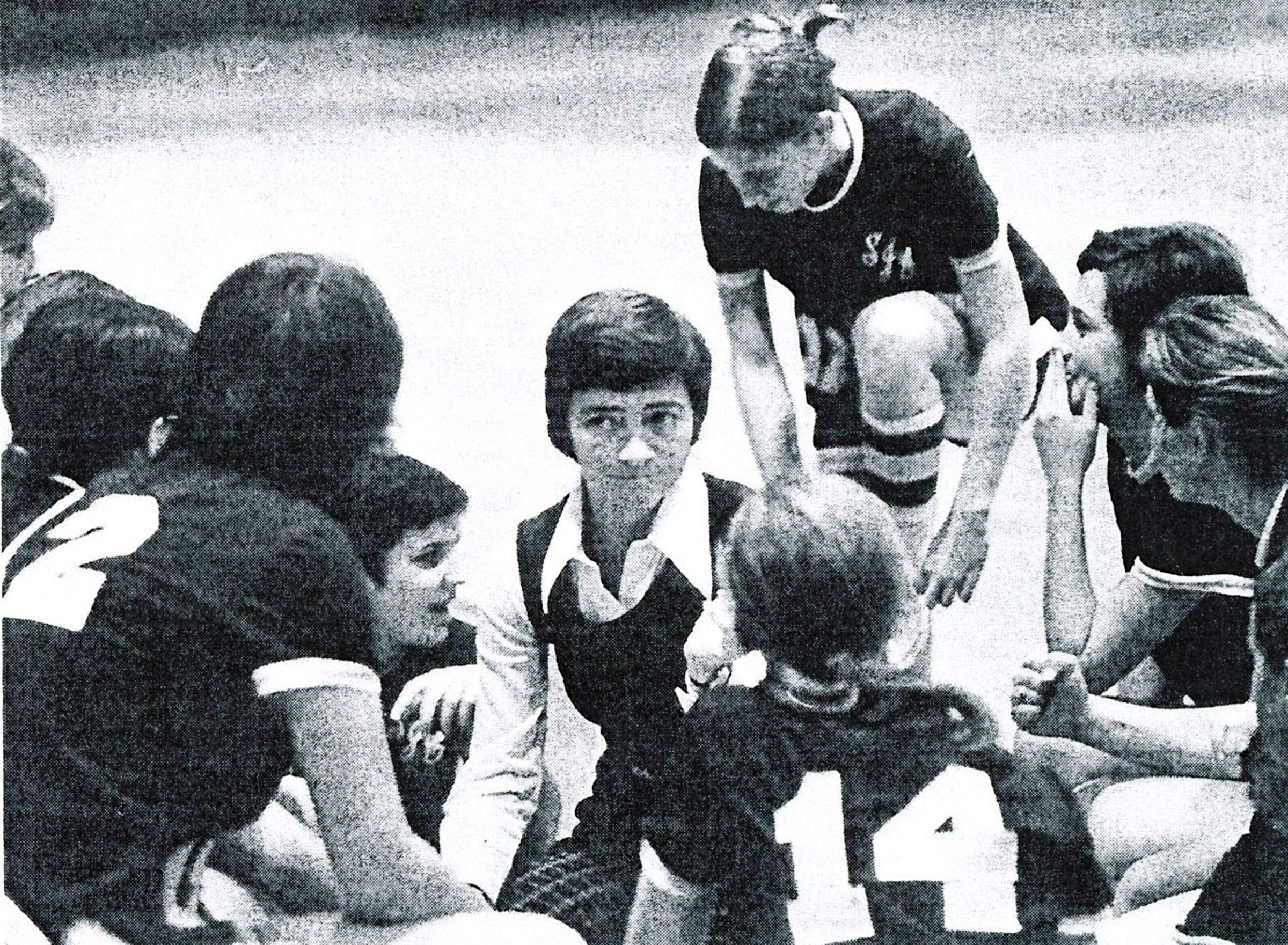 Ellen Ryan seen in 1973-74 as head coach of the first St. Joseph intercollegiate basketball team for women. She guided the Hawks to a 9-2 record. Ms. Ryan is at center.