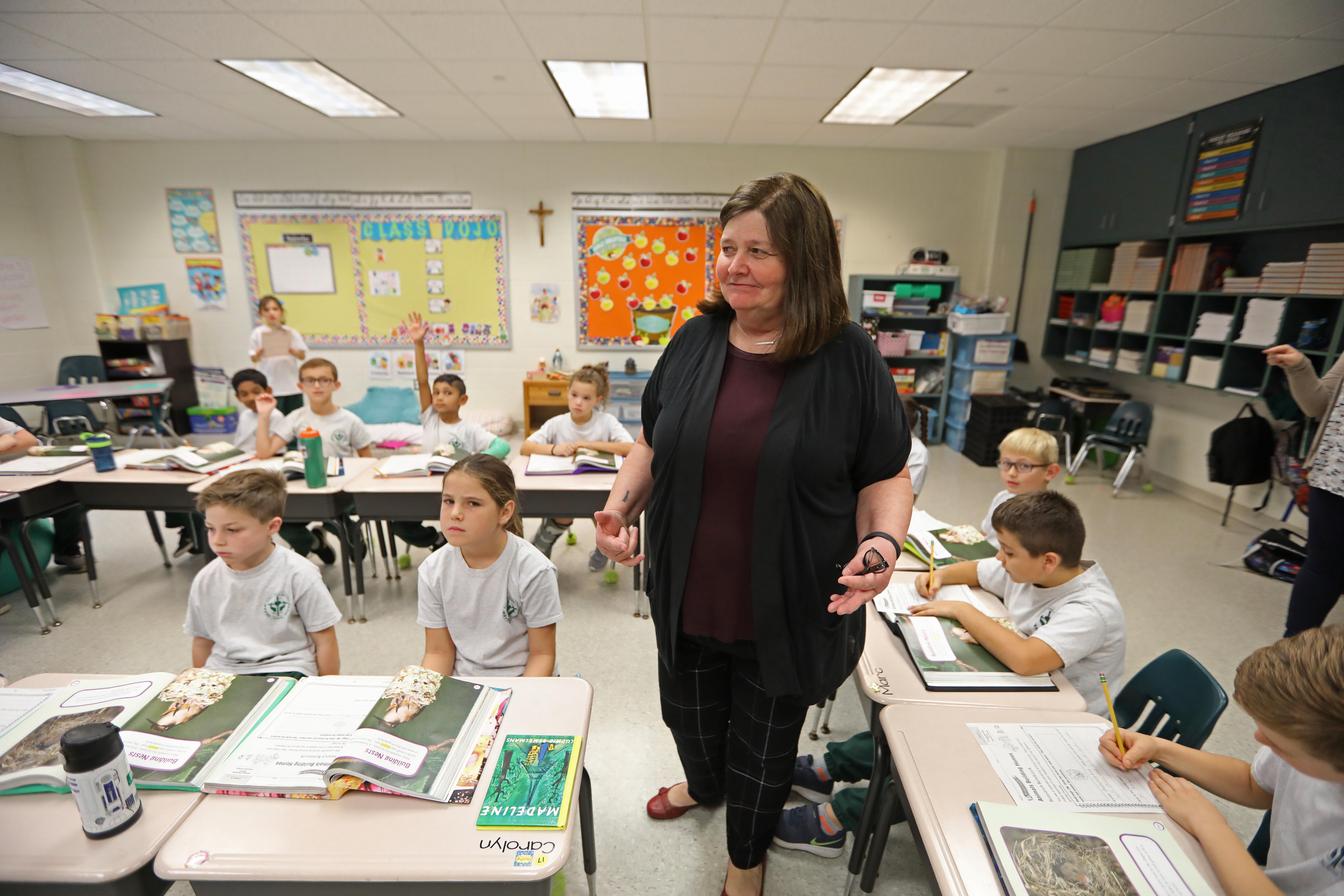 Principal Peg Egan talks in a second grade class at Sts. Peter and Paul School.
